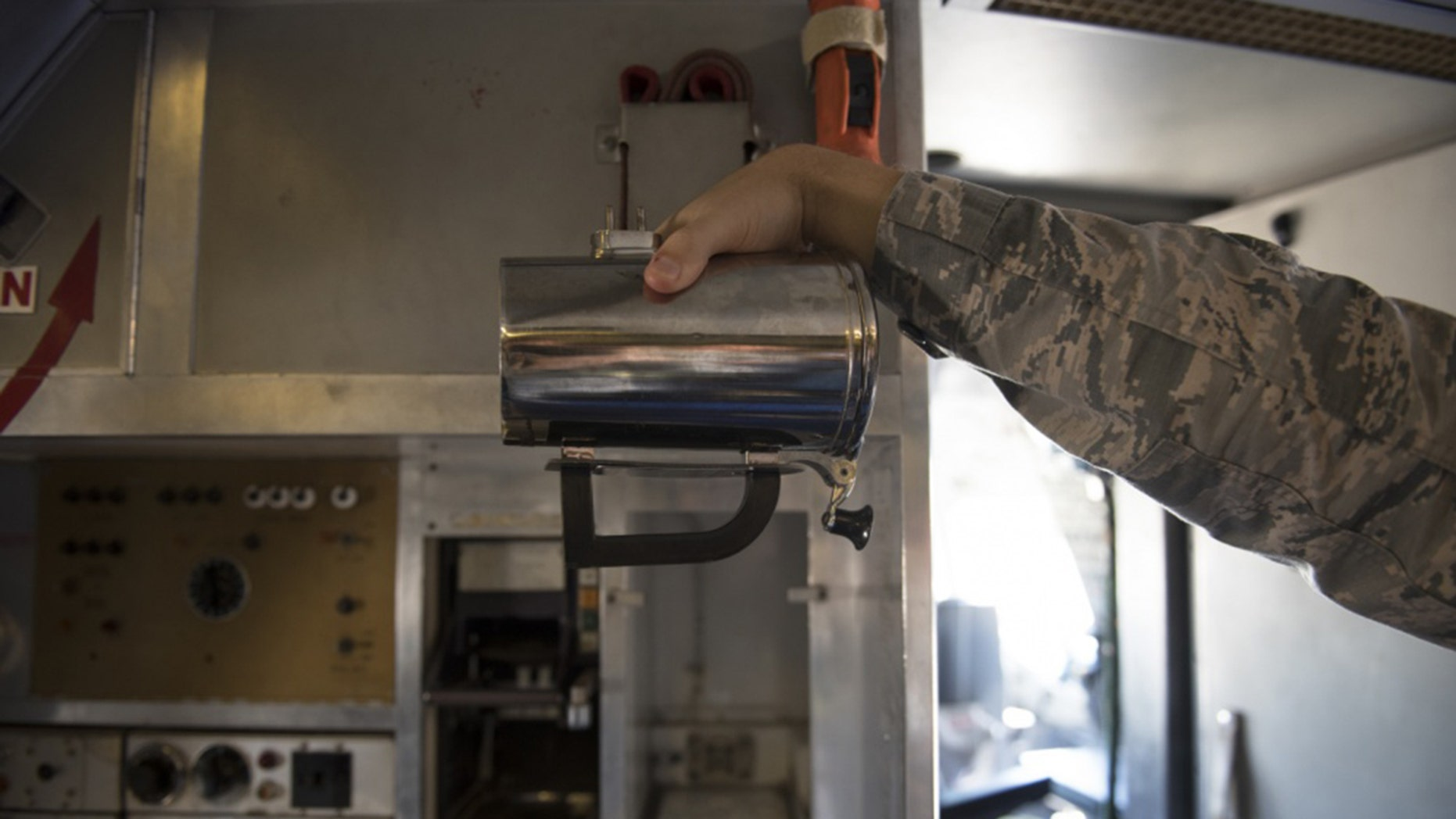 An Airman holds a hot cup inside a KC-10 Extender at Travis Air Force Base, Calif., in June.
