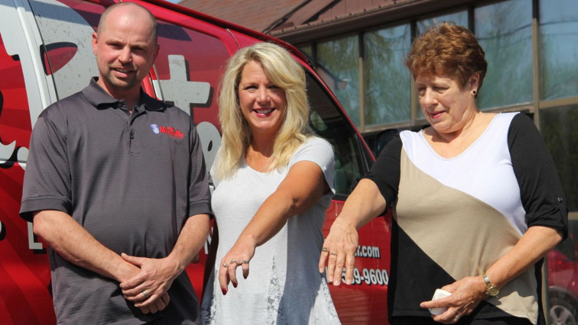 Trent Dawson, left, is pictured here with Cherie Kissiar, center, and Connie Keck, right, after giving them back their long-lost class rings.