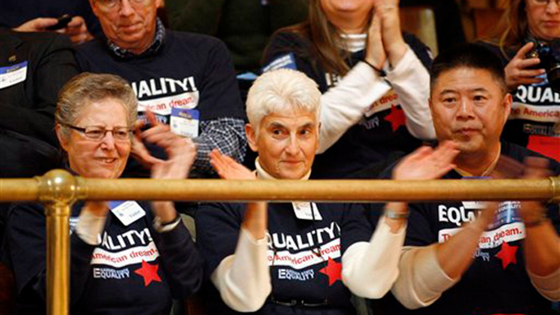 Feb. 13, 2012: Spectators in the balcony applaud the passage of the same-sex marriage bill in the New Jersey State Senate in Trenton. Gov. Chris Christie later vetoed the bill.