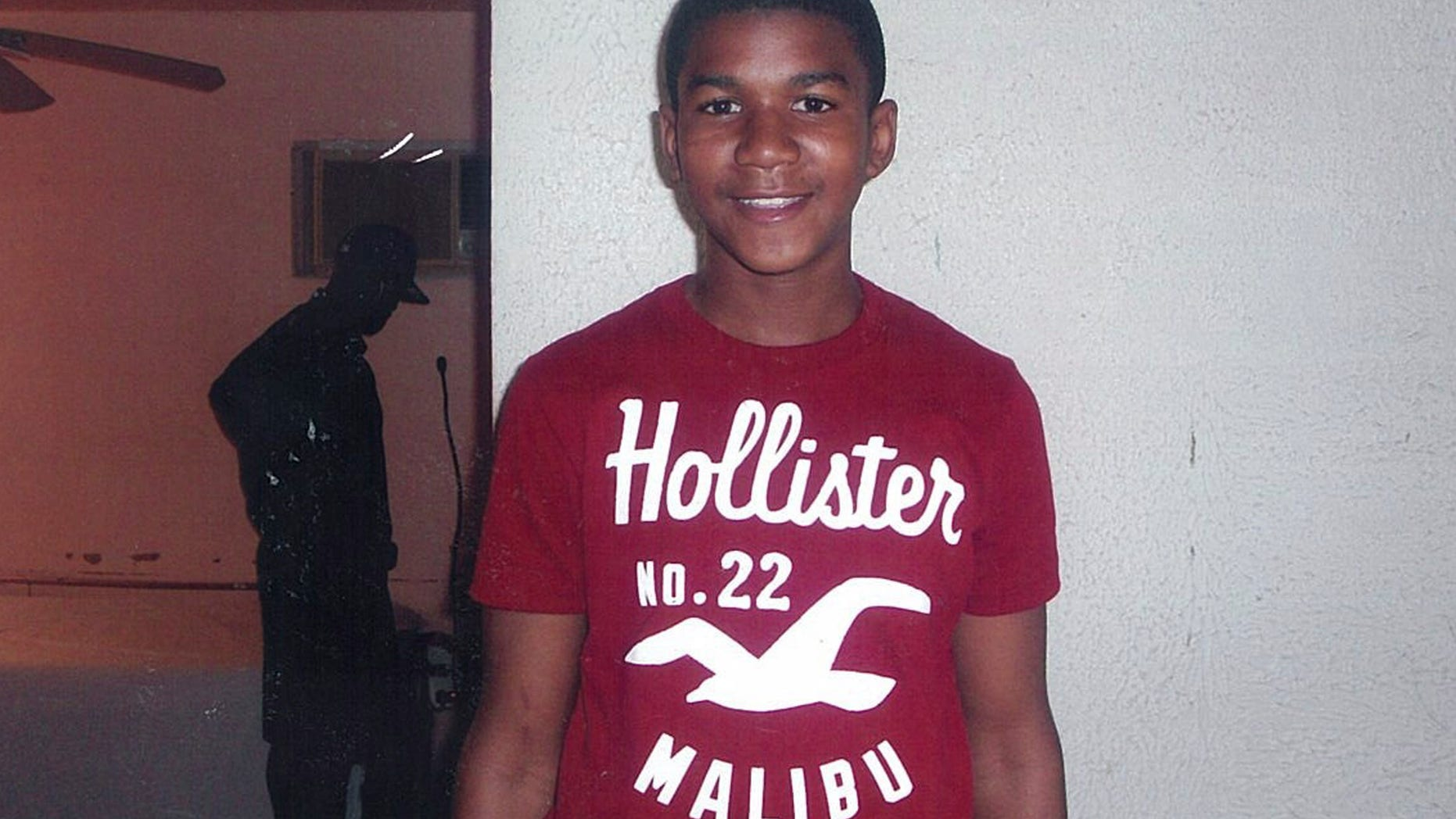 In this undated file family photo, Trayvon Martin poses for a family photo.