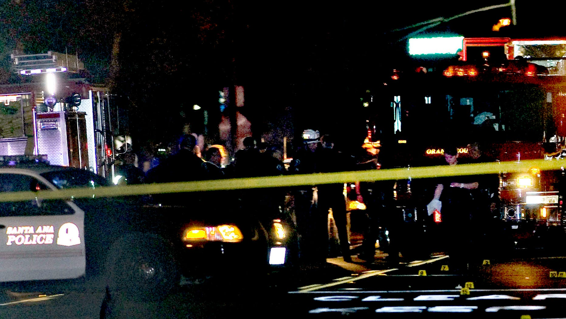 Oct. 31, 2014: Police and emergency respoders at the scene where three teenage girls trick-or-treating in costume were hit by a vehicle and killed while walking across a Southern California intersection in Santa Ana Calif.