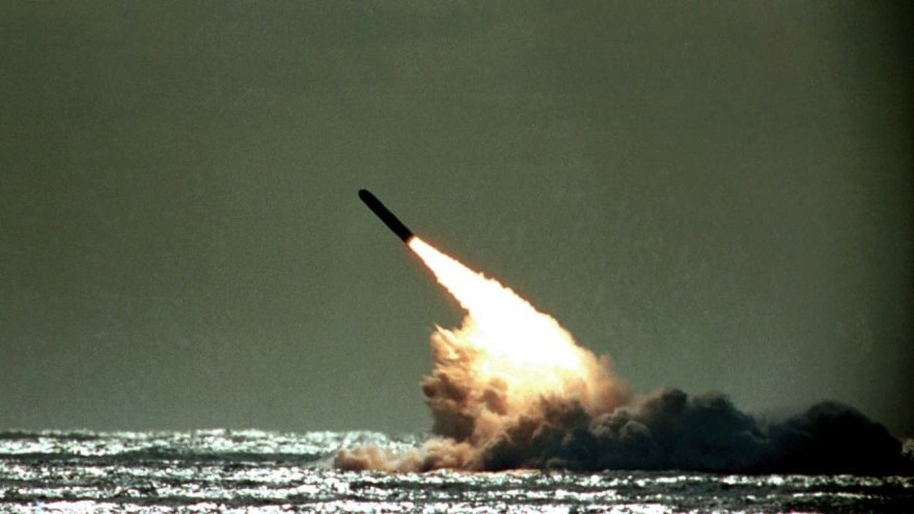 FILE 1989: A Trident II missile launched by the U.S. Navy during a performance evaluation from the submerged submarine USS Tennessee in the Atlantic Ocean off the coast of Cape Canaveral in Titusville, Fla., USA