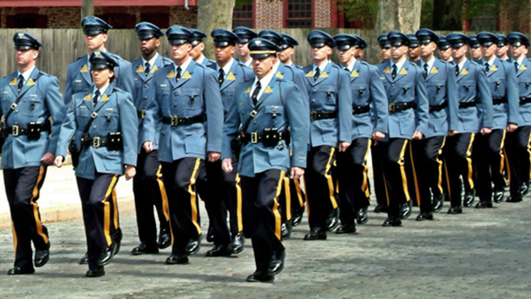A new lawsuit alleges the State Police was pressured into accepting more racially diverse candidates for the police academy.