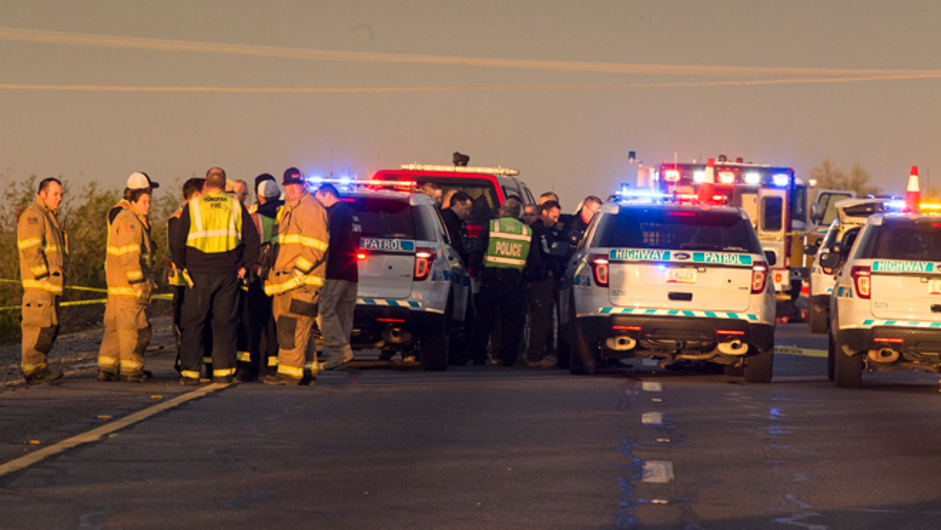 Emergency personnel gather at the scene where an Arizona Department of Public Safety trooper was shot, Thursday, Jan. 12, 2017, at the scene of a rollover accident on Interstate 10 near Tonopah, Ariz.