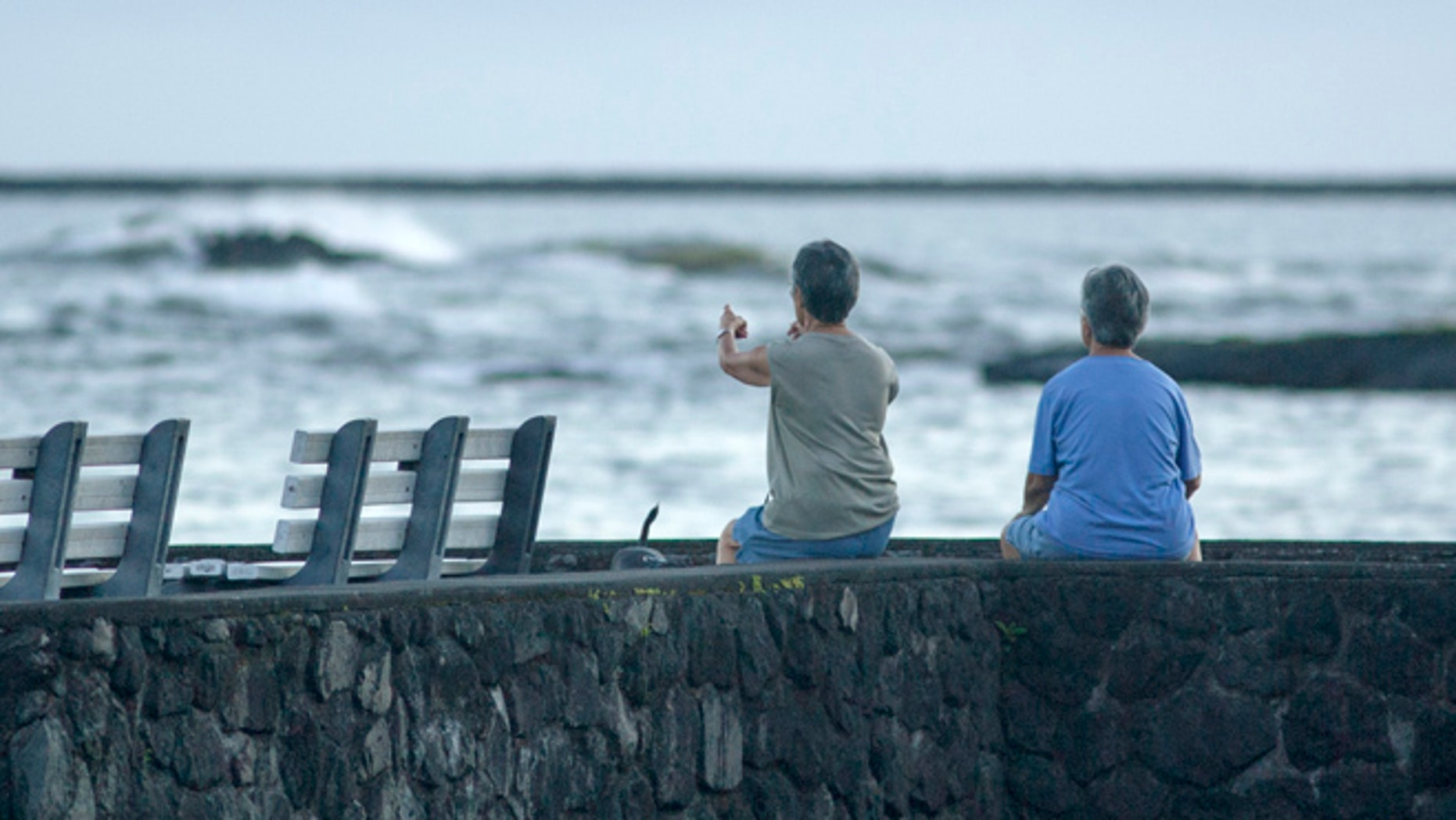 Aug. 31: Jeri, left, and Jen Nakano, both from Hilo, sit near the ocean in Hilo, Hawaii.