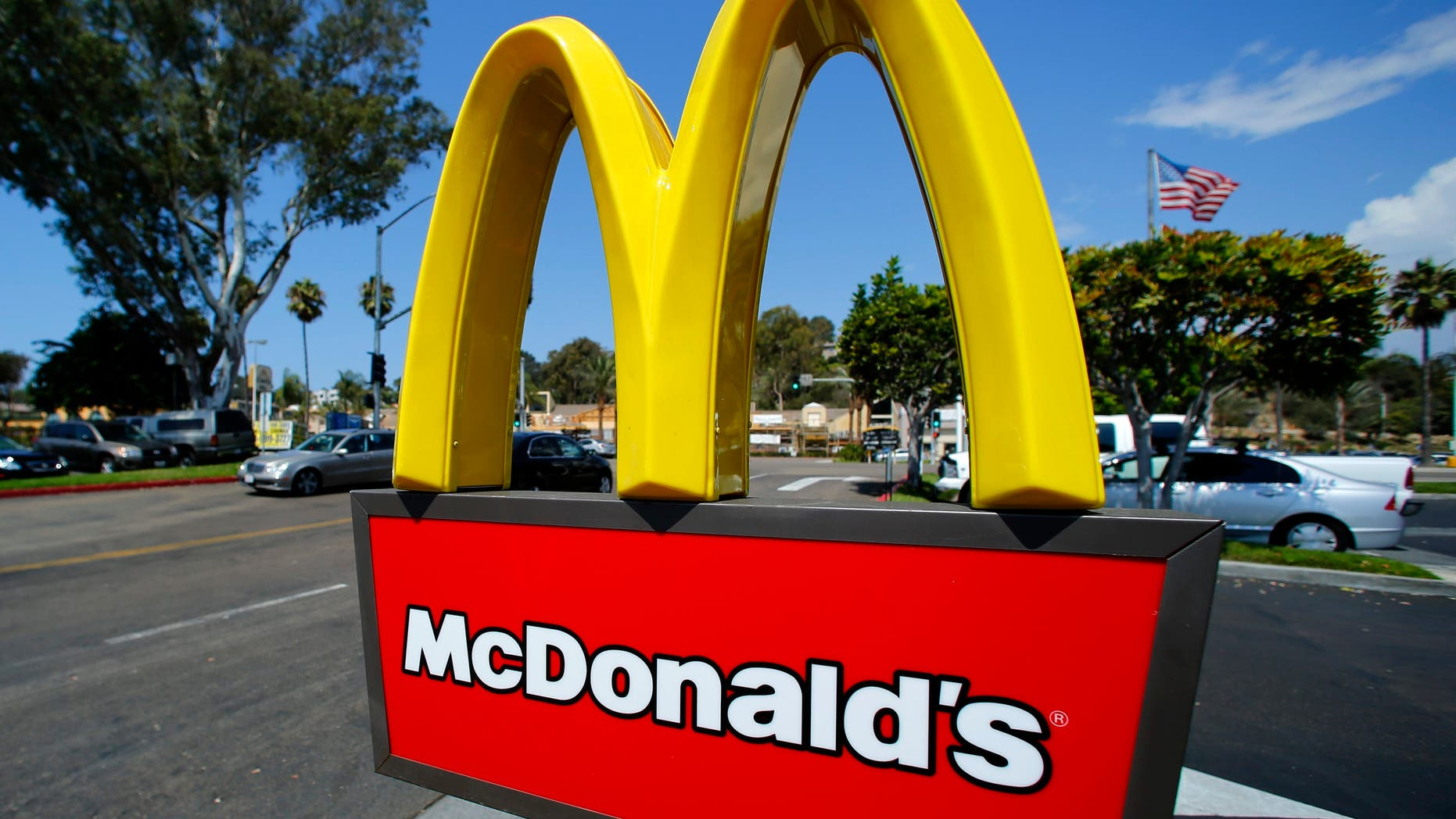A McDonald's sign is shown at the entrance to one of the company's restaurants in Del Mar, California September 10, 2012. REUTERS/Mike Blake (UNITED STATES - Tags: BUSINESS)