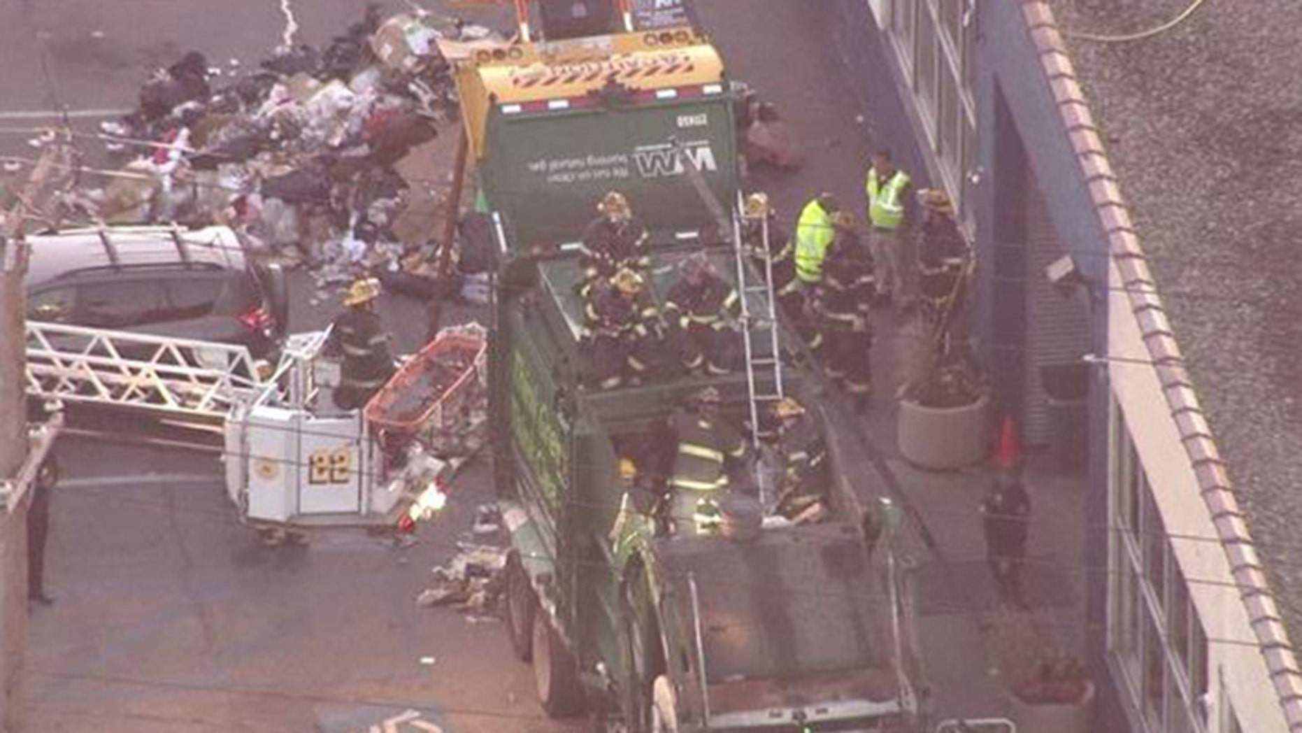 Nov. 27, 2017: Firefighters worked for hours Monday morning to rescue a man stuck in a garbage truck compactor in Philadelphia.