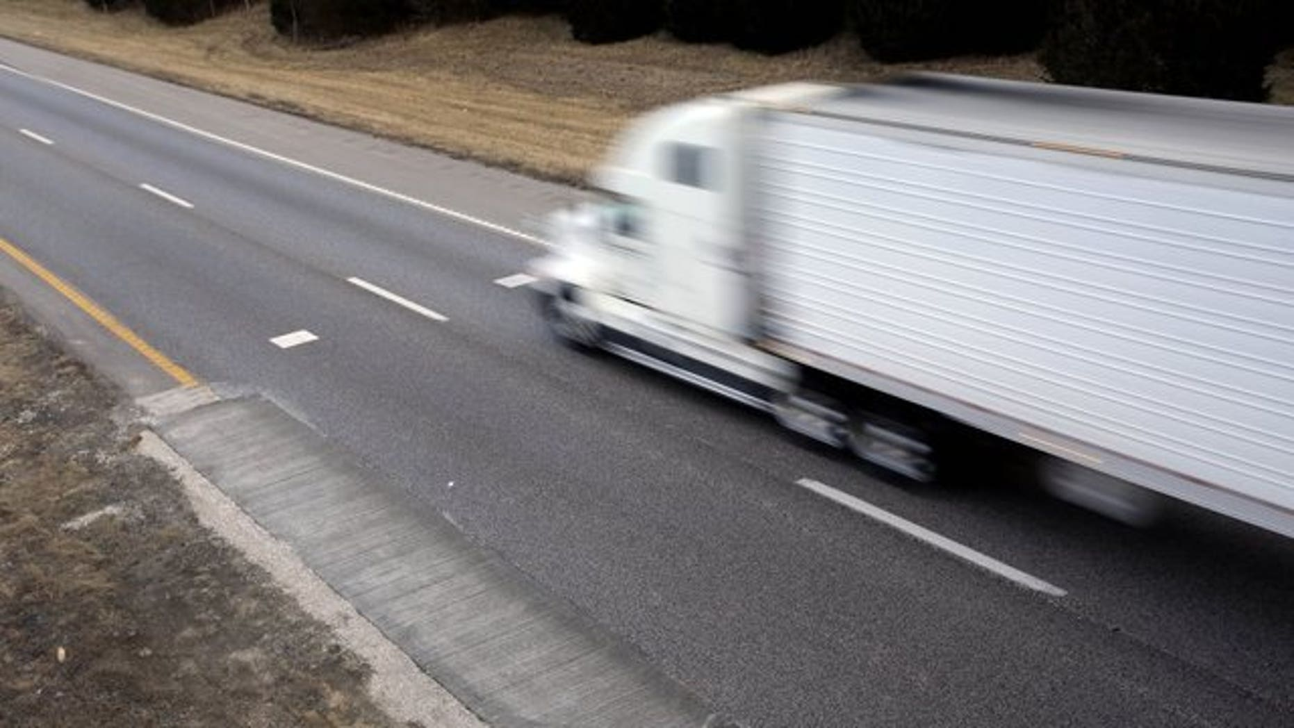A jury awarded $240,000 to Muslim drivers who say a trucking company fired them. (AP Photo/Jeff Roberson)