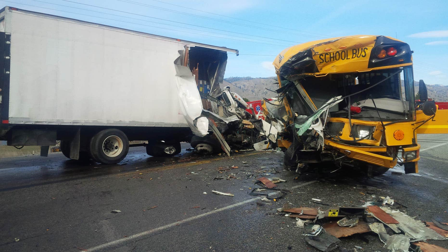 March 5, 2015: This photo provided by the Washington State Patrol shows the scene of an accident in which a motorist was killed and five students and others were injured in a crash involving a school bus, box truck and car near Orondo in Central Washington state.