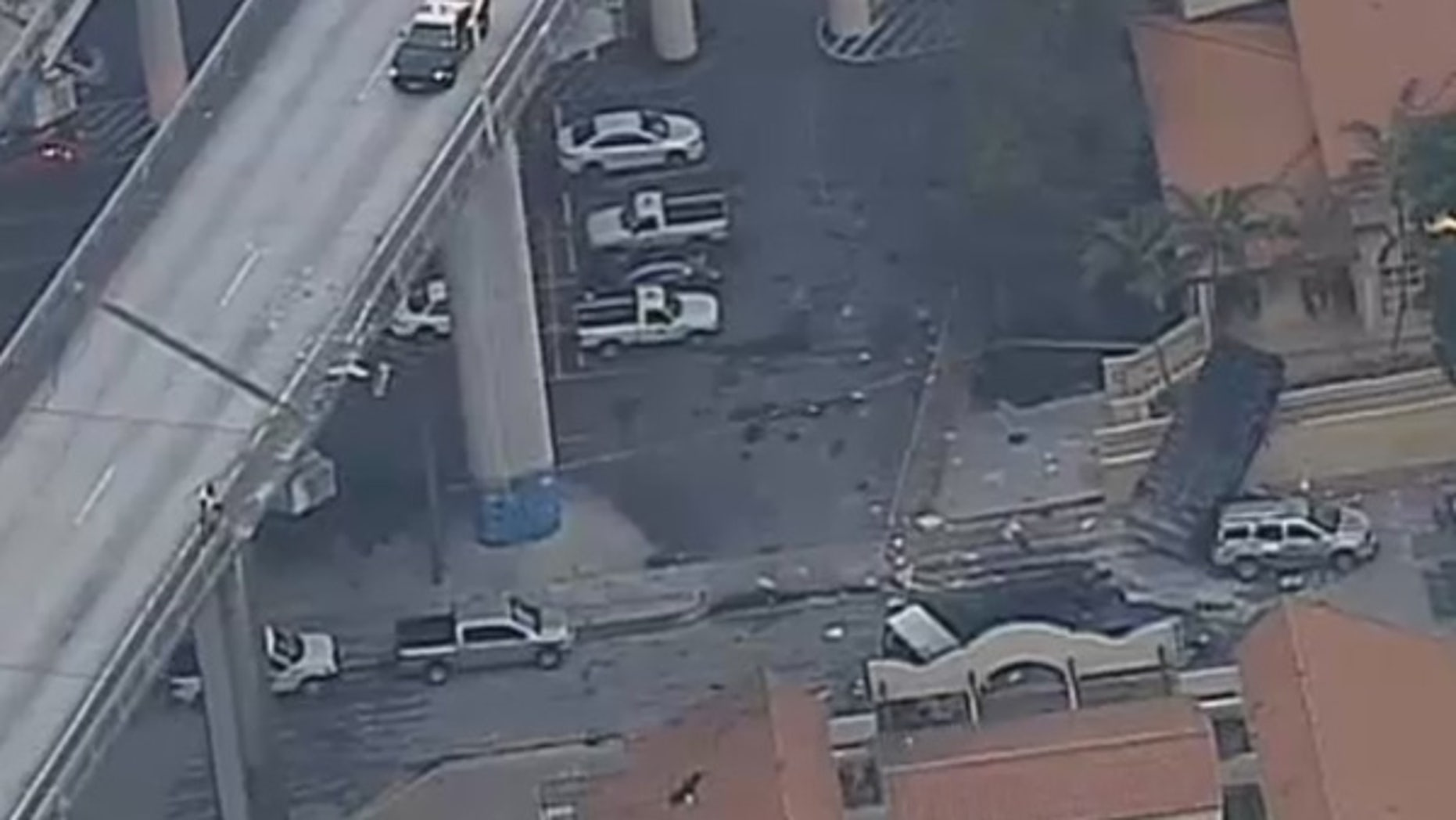 A garbage truck fell nearly 100 feet off Interstate 95 in Miami on Monday.