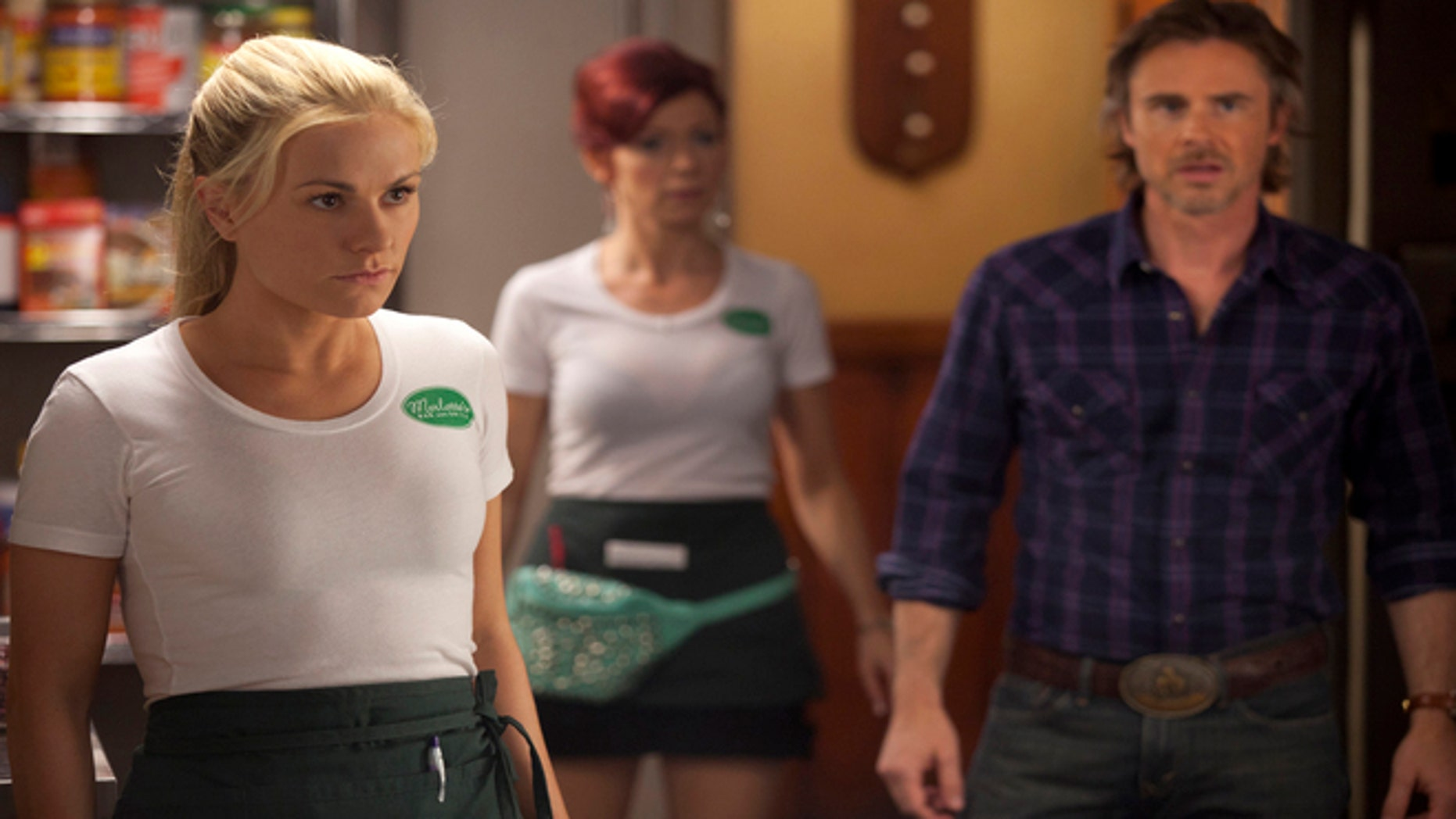 This image released by HBO shows, from left, Anna Paquin as Sookie Stackhouse, Carrie Preston as Arlene Fowler, Sam Trammell as Sam Merlotte in a scene from 'True Blood.'