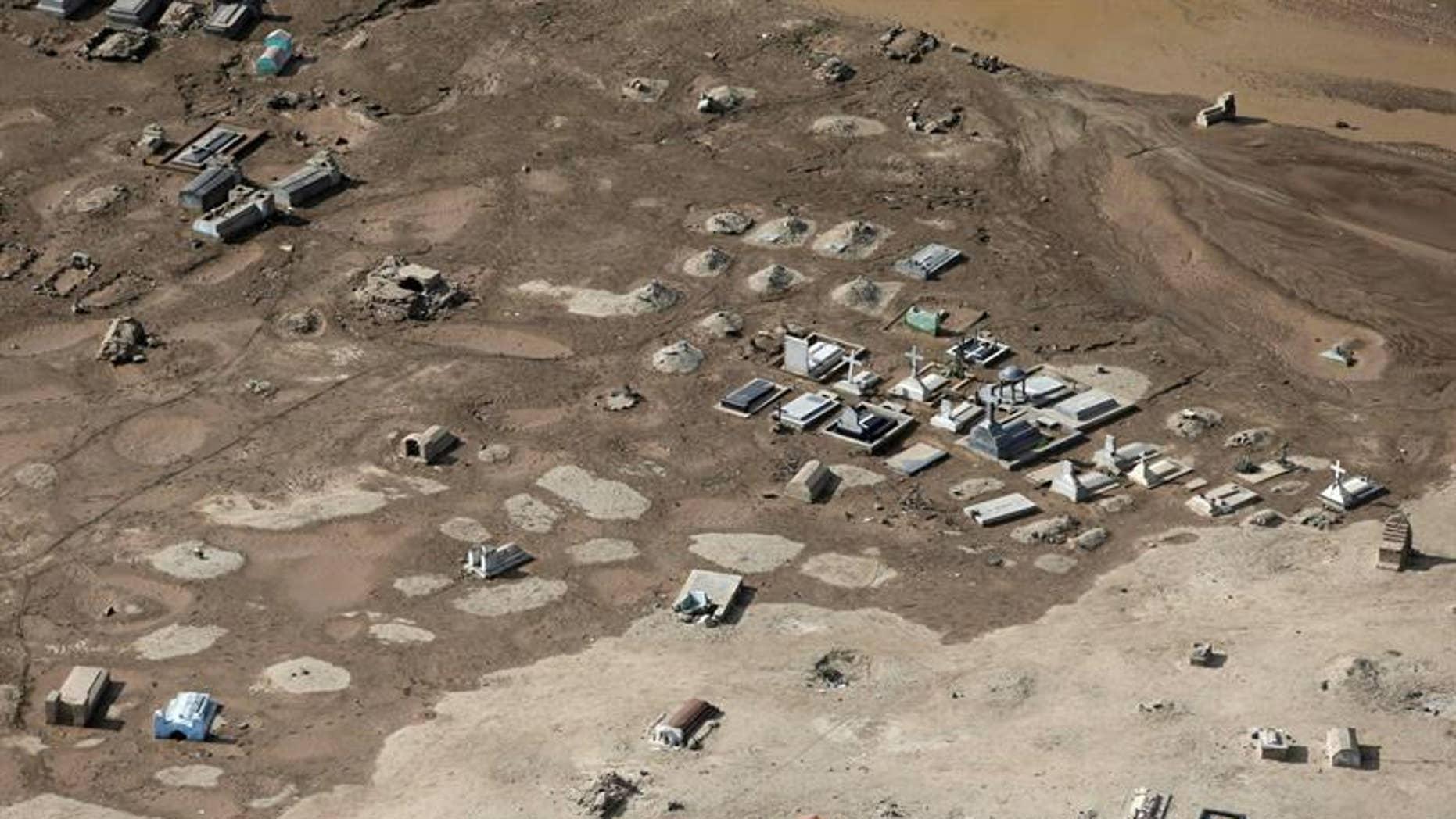 Aerial photograph shows a flooded cemetery in Trujillo, Peru.