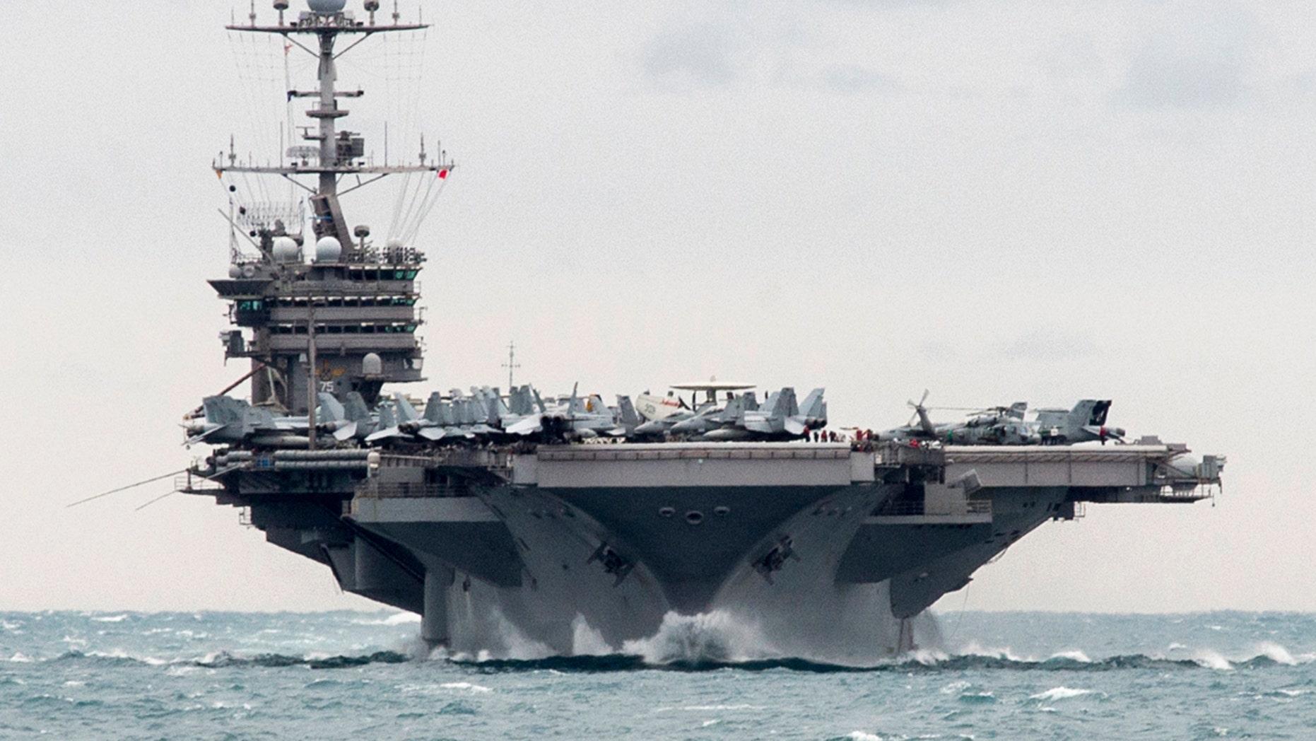 FILE:  2015: Aircraft carrier USS Harry S. Truman in the Strait of Hormuz. (U.S. Navy via AP)