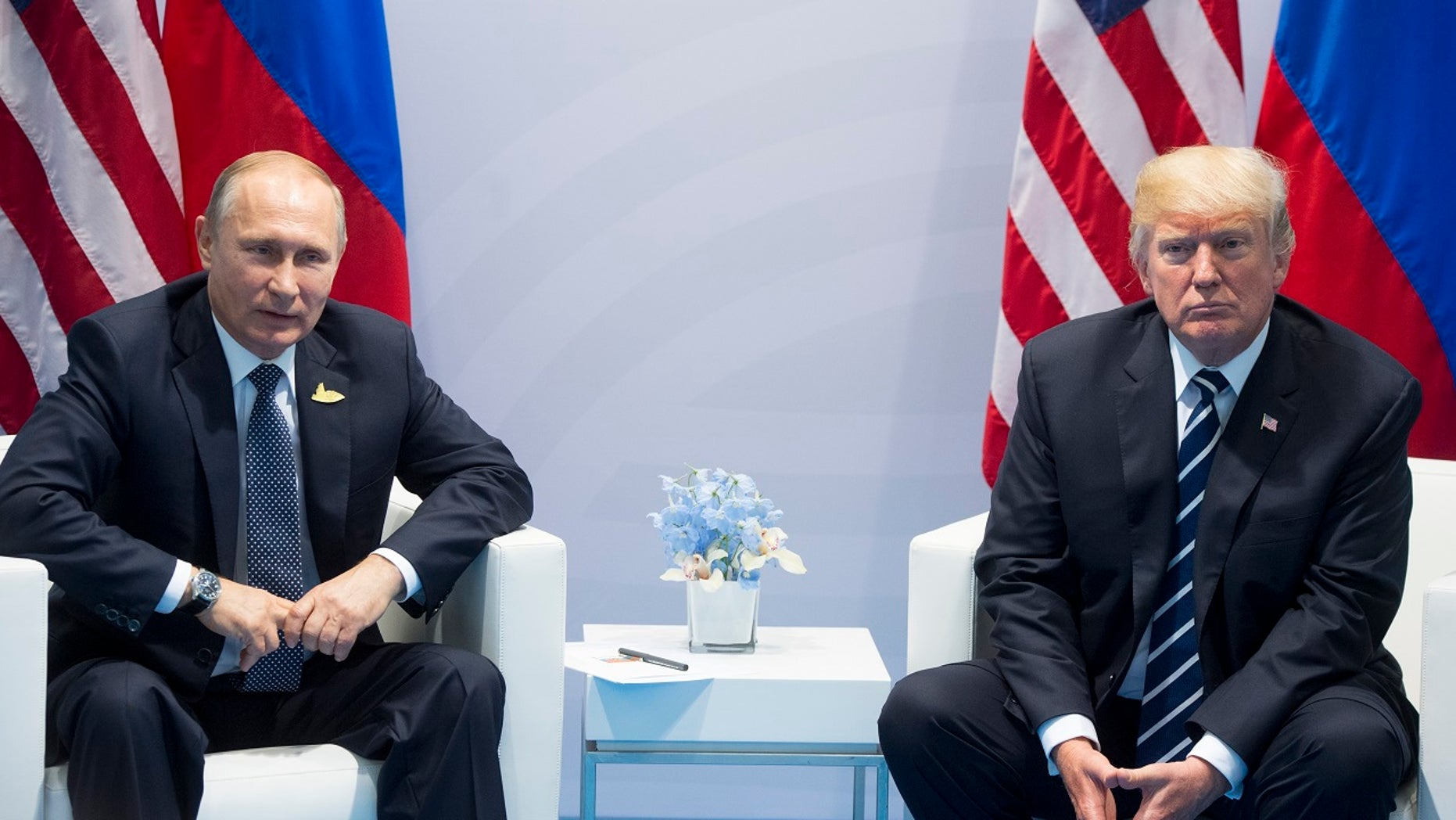FILE - In this July 7, 2017, file photo, U.S. President Donald Trump, right, and Russian President Vladimir Putin pose for a photo during the G20 summit in Hamburg Germany. (AP Photo/Marcellus Stein, File)