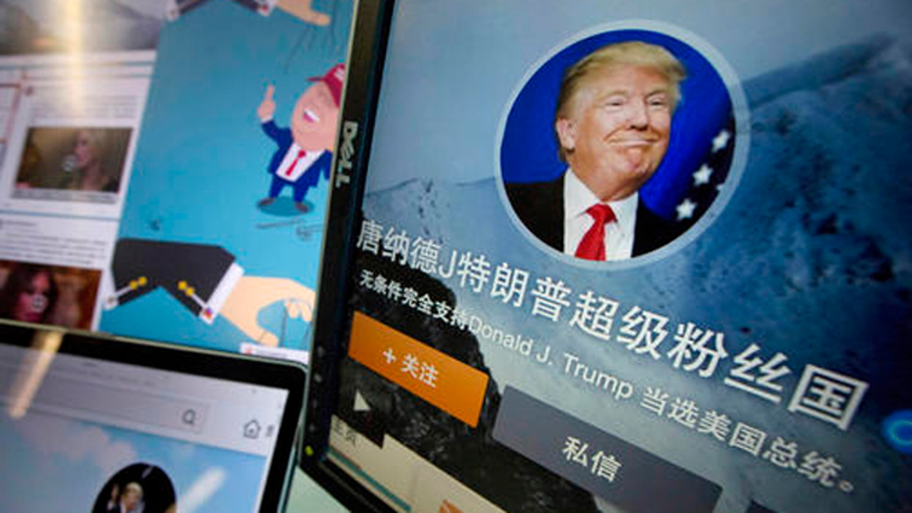 """In this May 18, 2016 photo, Chinese fan websites for Donald Trump are displayed on a computer with the words """"Donald J. Trump super fan nation, Full and unconditional support for Donald J. Trump to be elected U.S. president"""" in Beijing, China. China features prominently in the rhetoric of presumed Republican presidential candidate Donald Trump, who accuses the country of stealing American jobs and cheating at global trade. In China itself, though, hes only now emerging as a public figure, despite a notoriety elsewhere for his voluble utterances, high-profile businesses and reality TV show. (AP Photo/Ng Han Guan)"""