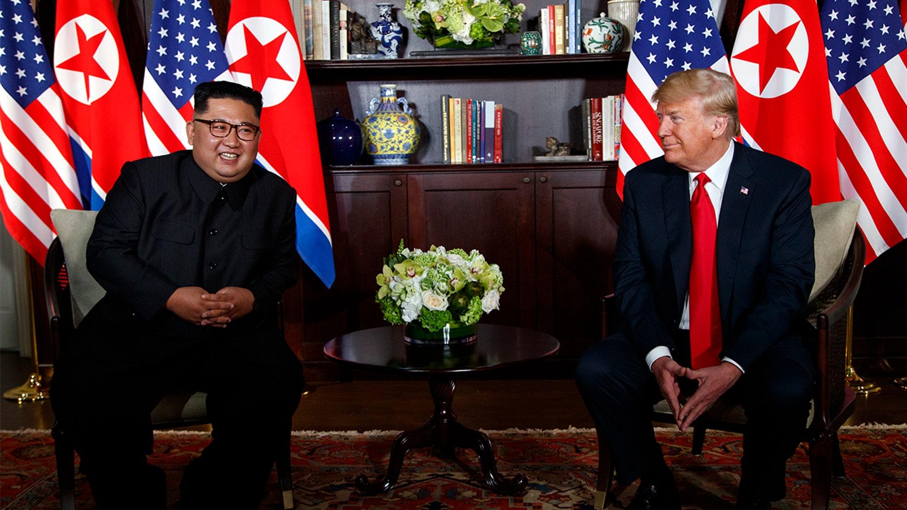 President Donald Trump meets with North Korean leader Kim Jong Un on Sentosa Island, Tuesday, June 12, 2018, in Singapore.