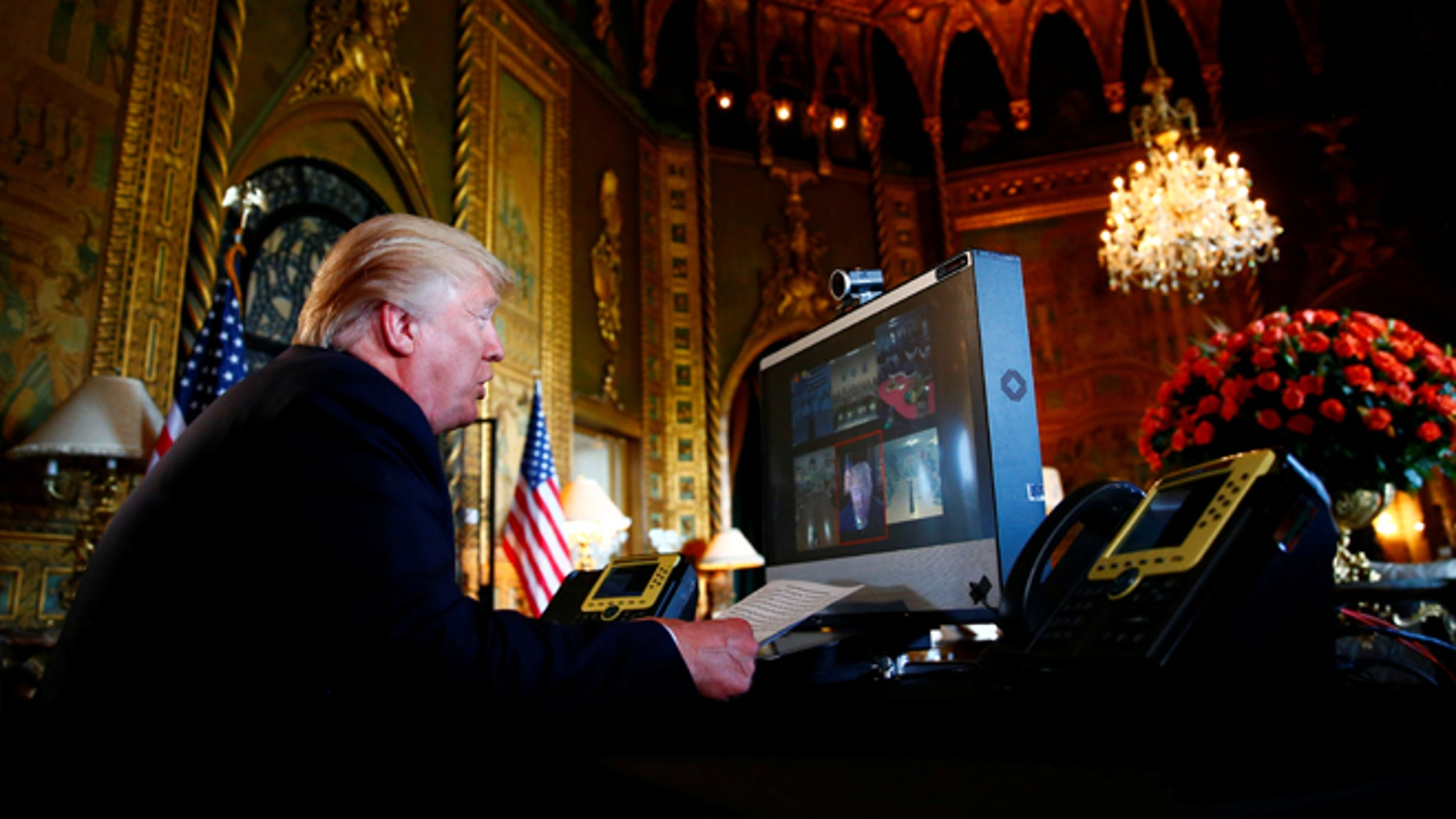 President Donald Trump speaks via videoconference to U.S. troops, from his Mar-a-Lago estate in Palm Beach, Fla., Nov. 23, 2017.