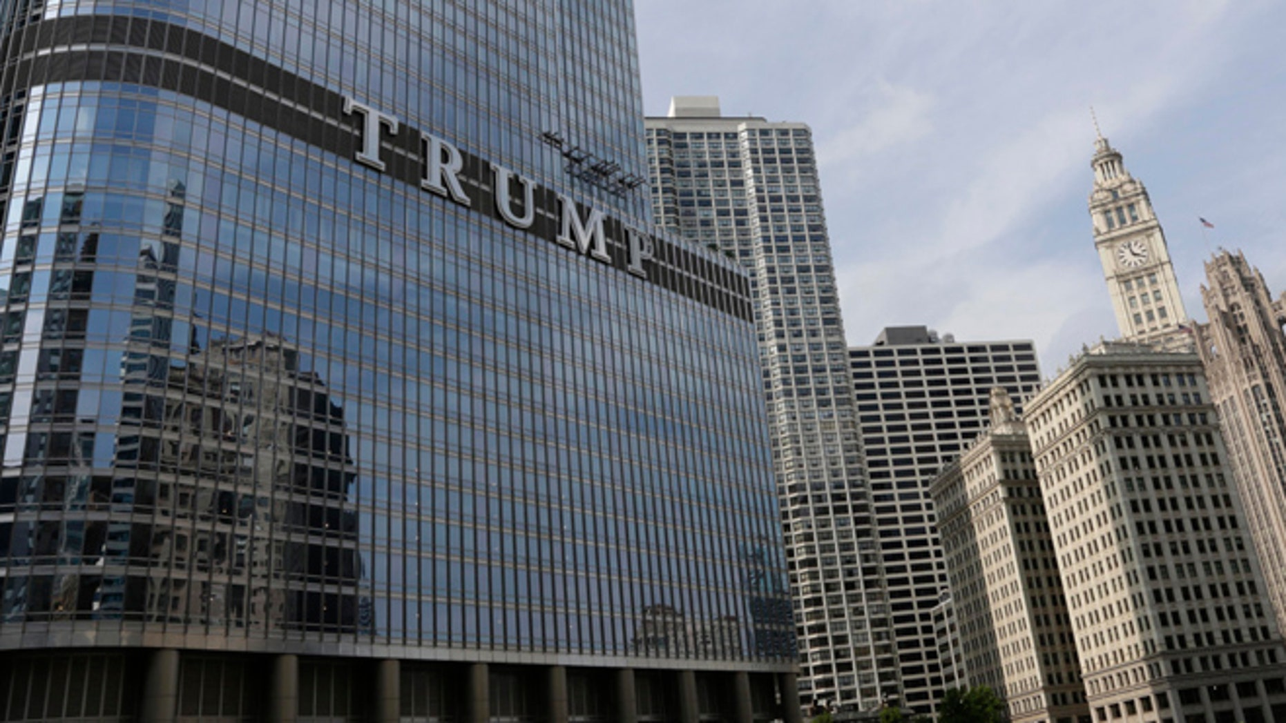 Newly installed 20-foot-tall letters spelling out T-R-U-M-P are seen on the side of real estate billionaire Donald Trump's skyscraper in Chicago, Thursday, June 12, 2014. The letters have triggered a war of words between Trump and Chicago Mayor Rahm Emanuel.(AP Photo/Stacy Thacker)