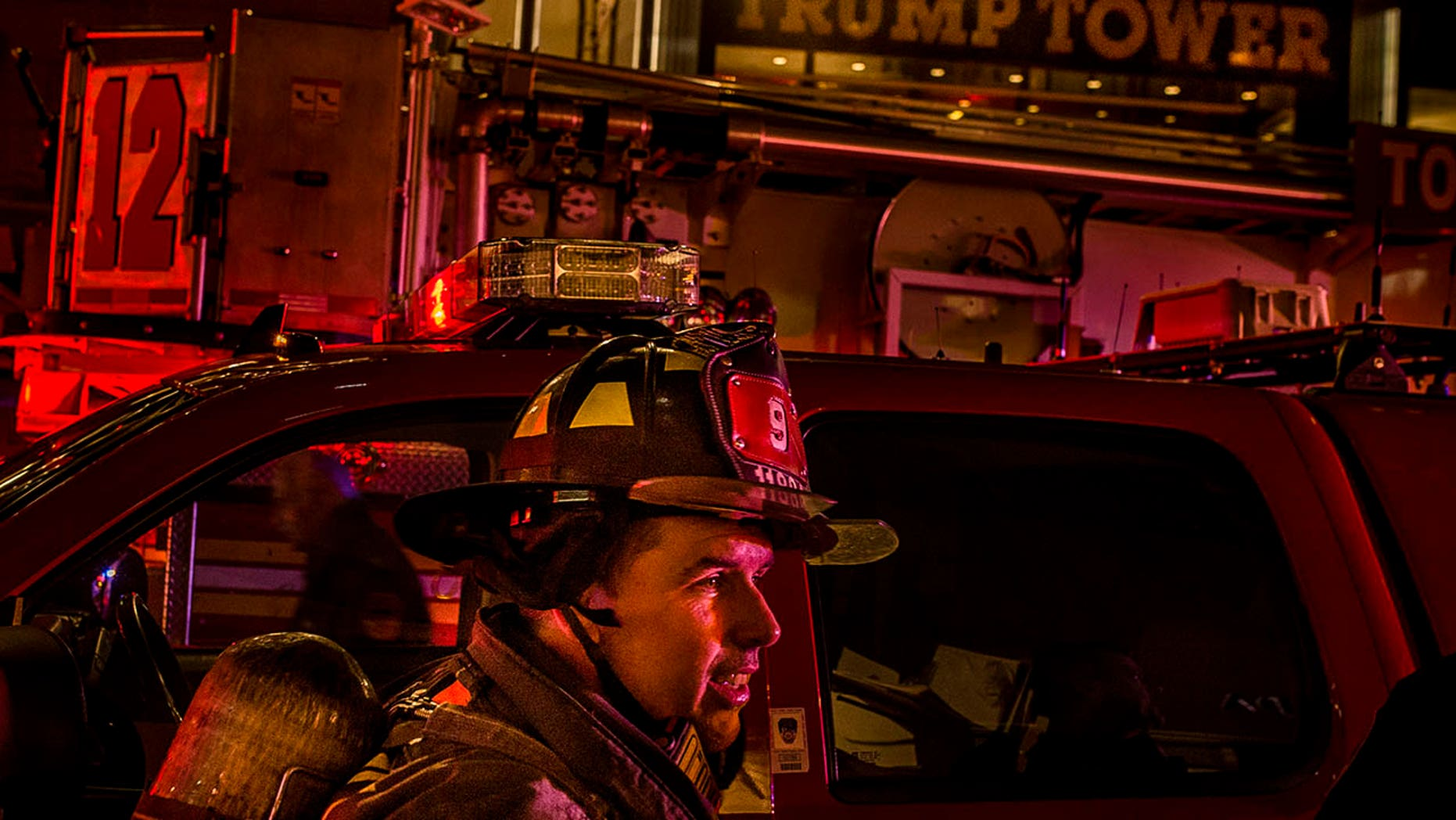 A firefighter works in front of Trump Tower after a fire in New York, April 7, 2018.