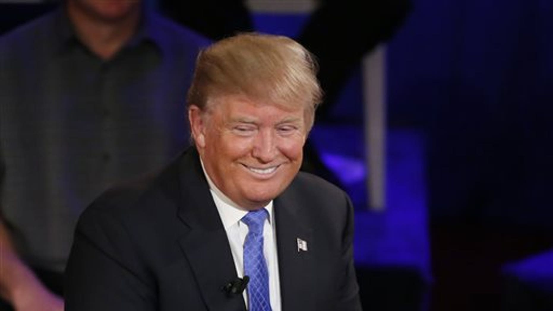 Republican presidential candidate Donald Trump smiles during a town hall in the historic Riverside Theatre on March 29, 2016, in Milwaukee. (AP Photo/Charles Rex Arbogast)
