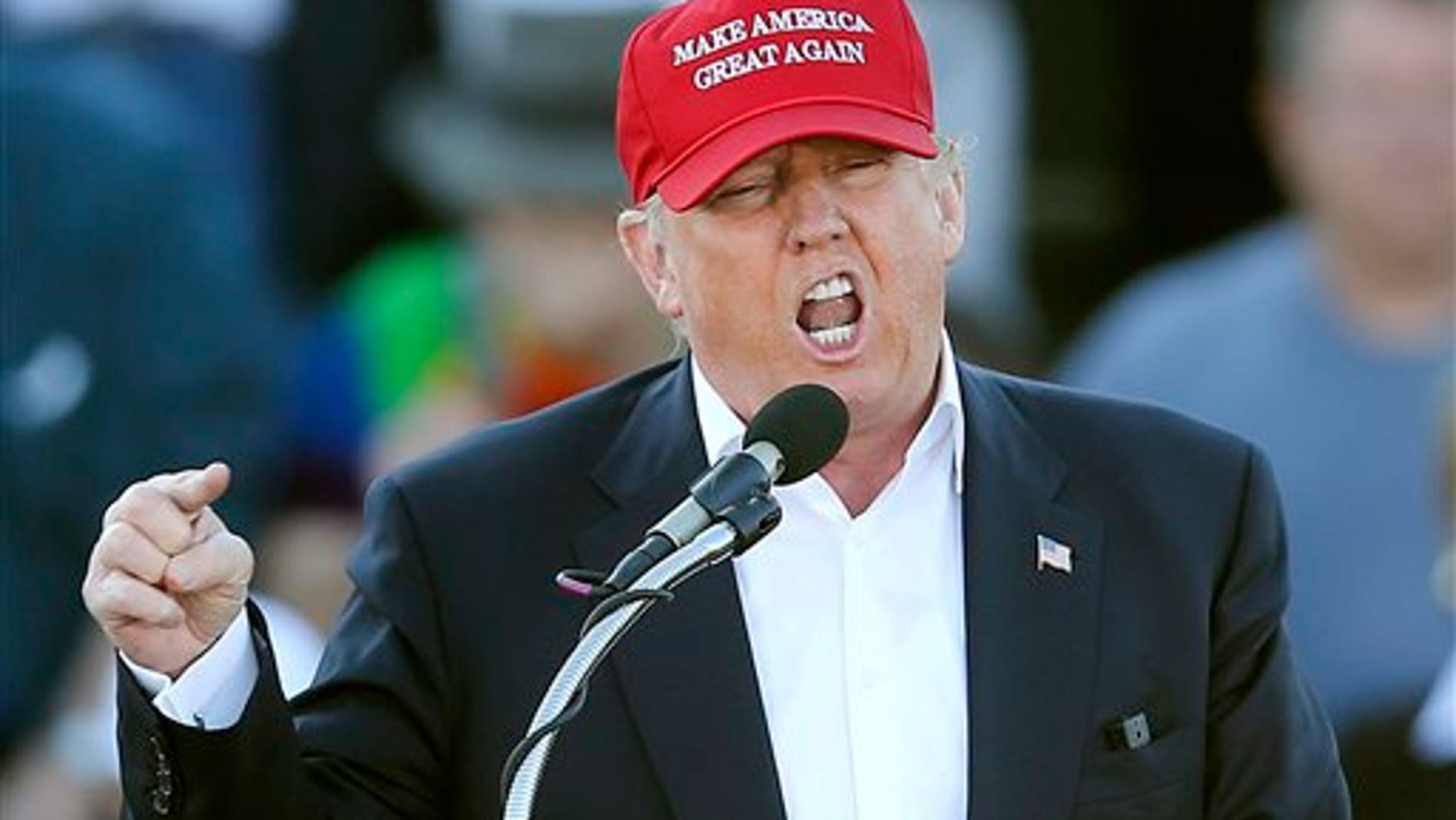 """FILE - In this Feb. 28, 2016, file photo, Republican presidential candidate Donald Trump speaks during a rally in Madison, Ala. Republican presidential front-runner Trump has staked out uncompromising positions on Asia policy that could potentially strain U.S. relations with the region if he wins the White House. He says China is ripping off America in trade and should be slapped with a fat import tax. And he claims U.S. military allies Japan and South Korea are freeloading and need to pull their weight. The pan-Pacific trade pact negotiated by the Obama administration is a """"total disaster."""" (AP Photo/John Bazemore, File)"""