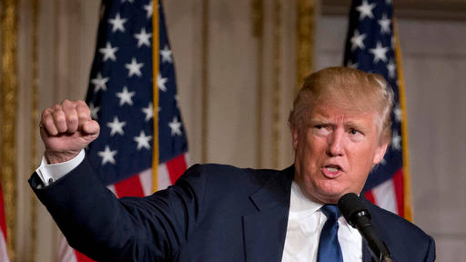 Republican presidential candidate Donald Trump speaks during the Palm Beach County GOP Lincoln Day Dinner at the Mar-A-Lago Club, Sunday, March 20, 2016, in Palm Beach, Fla. (AP Photo/Wilfredo Lee)