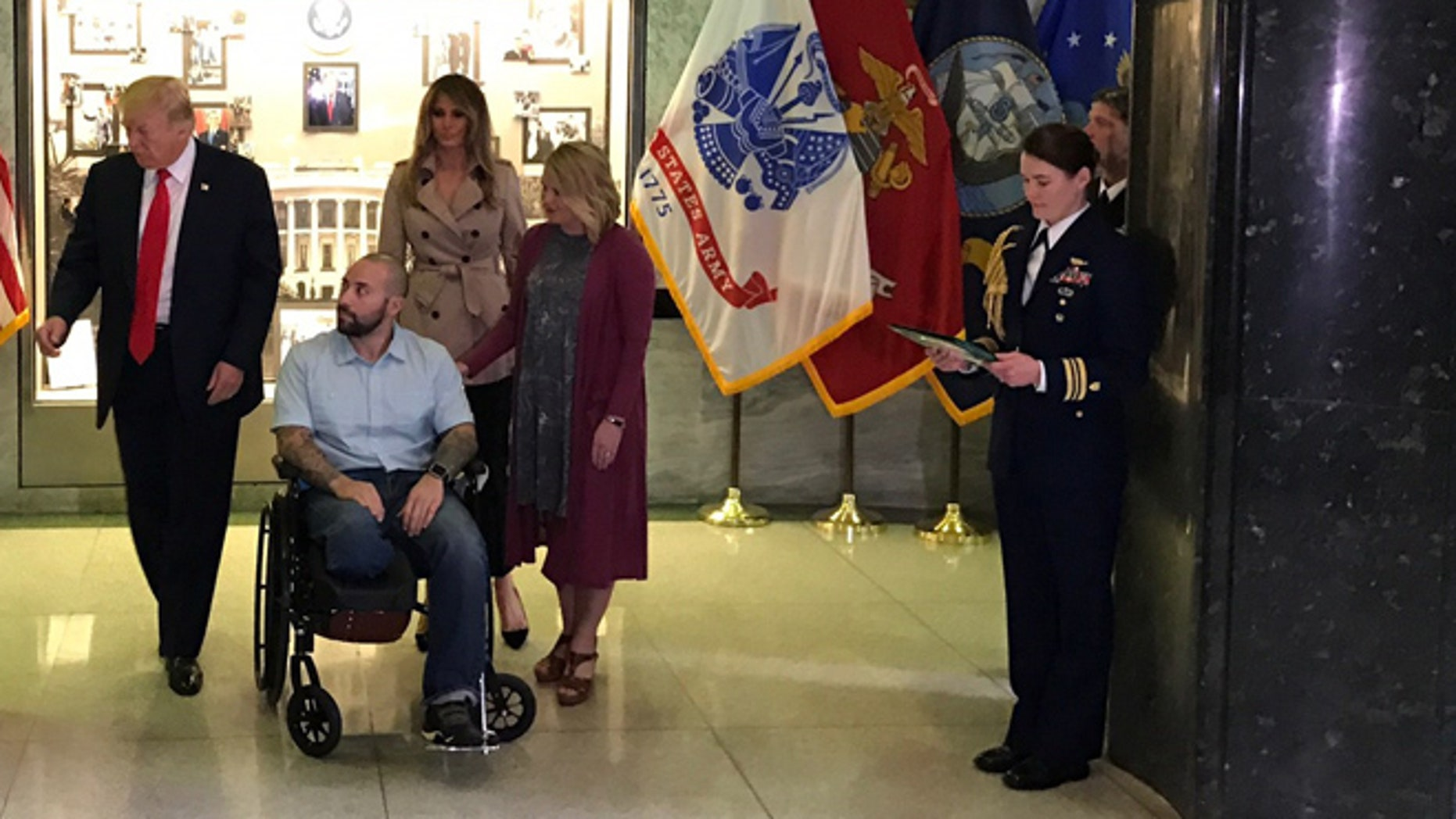 April 22, 2017: Donald Trump presents Purple Heart award to Army Sgt. Alvaro Barrietos. First lady Melania Trump and wife Tammy Barrietos are behind, to Barrietos' left. Walter Reed National Medical Center, Bethesda, Md. (White House submitted photo.)