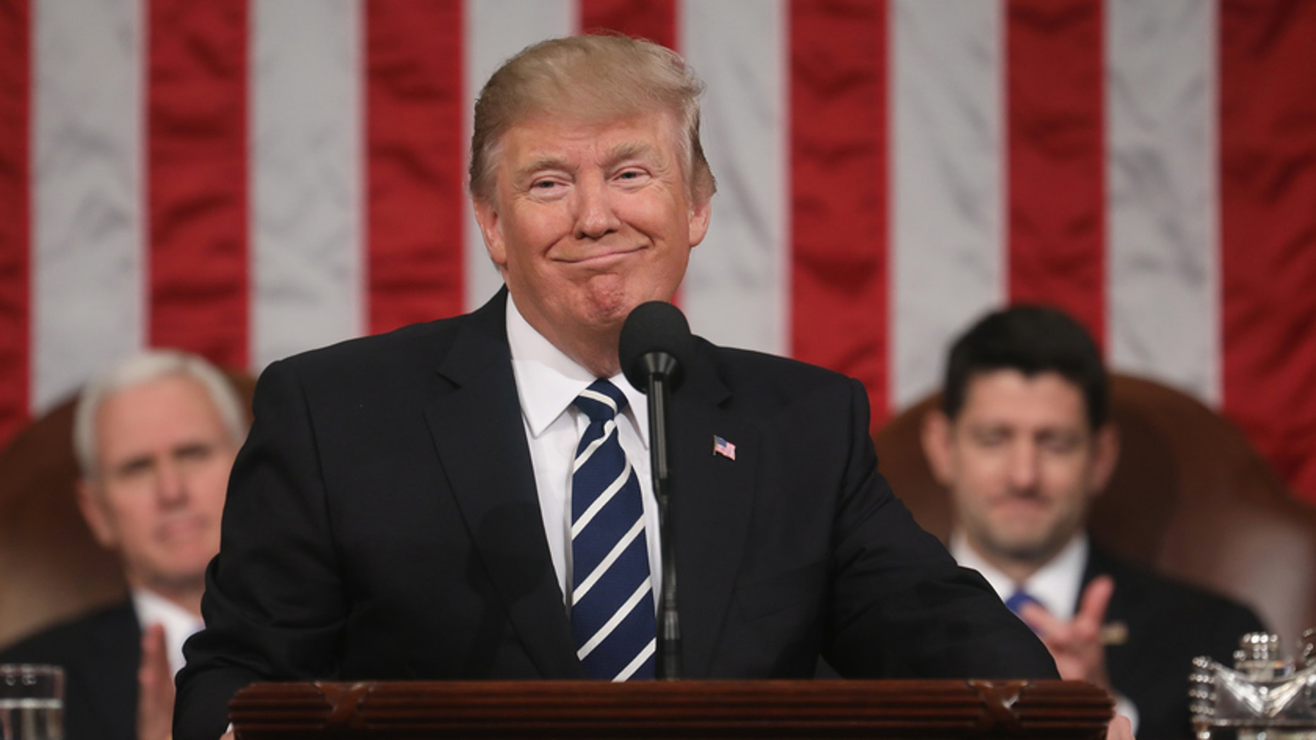 FILE -- President Donald Trump delivers his first address to a joint session of Congress from the floor of the House of Representatives iin Washington, February 28, 2017.