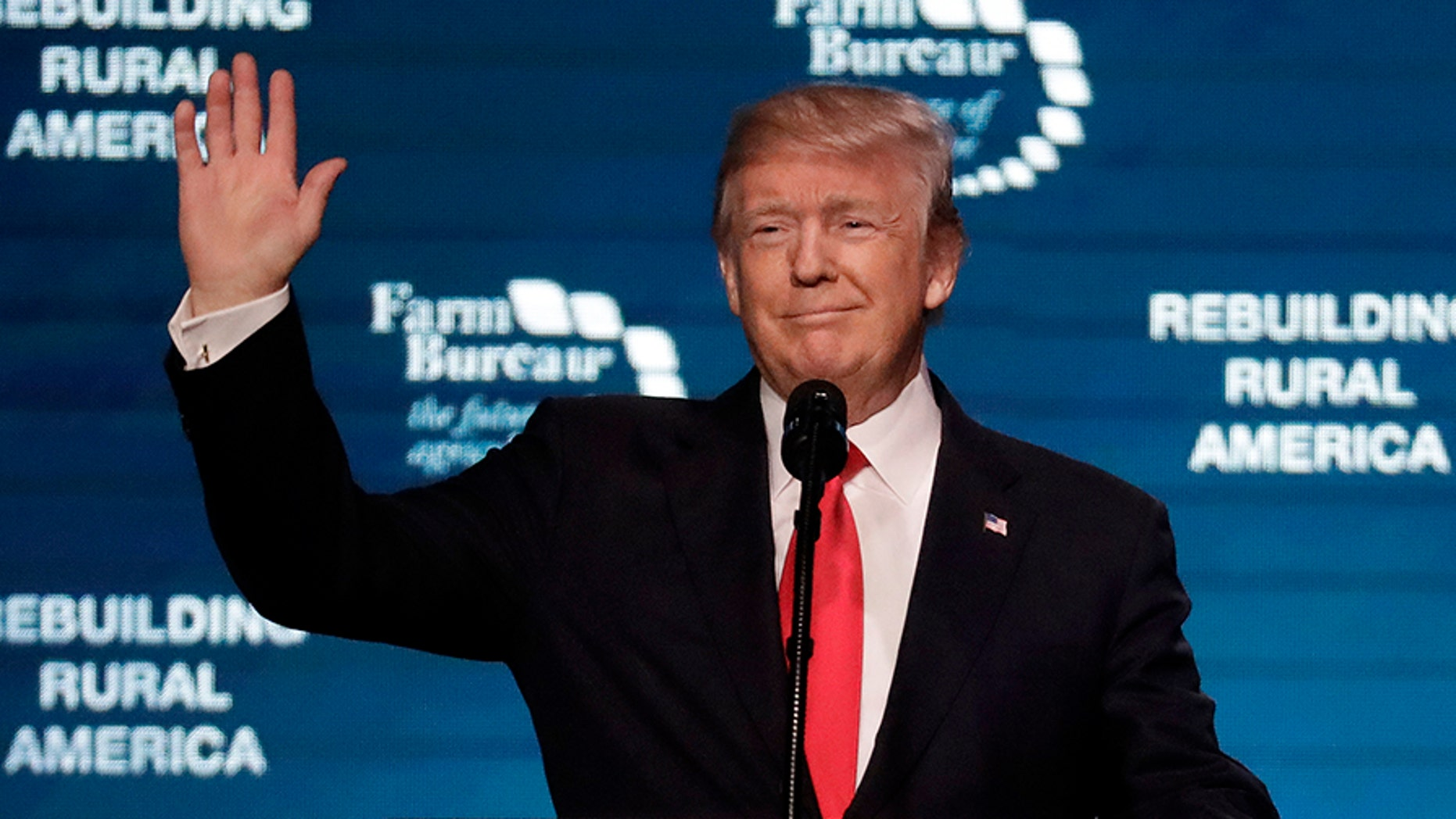 President Donald Trump waves as he speaks at the American Farm Bureau Federation annual convention Monday, Jan. 8, 2018, in Nashville, Tenn.