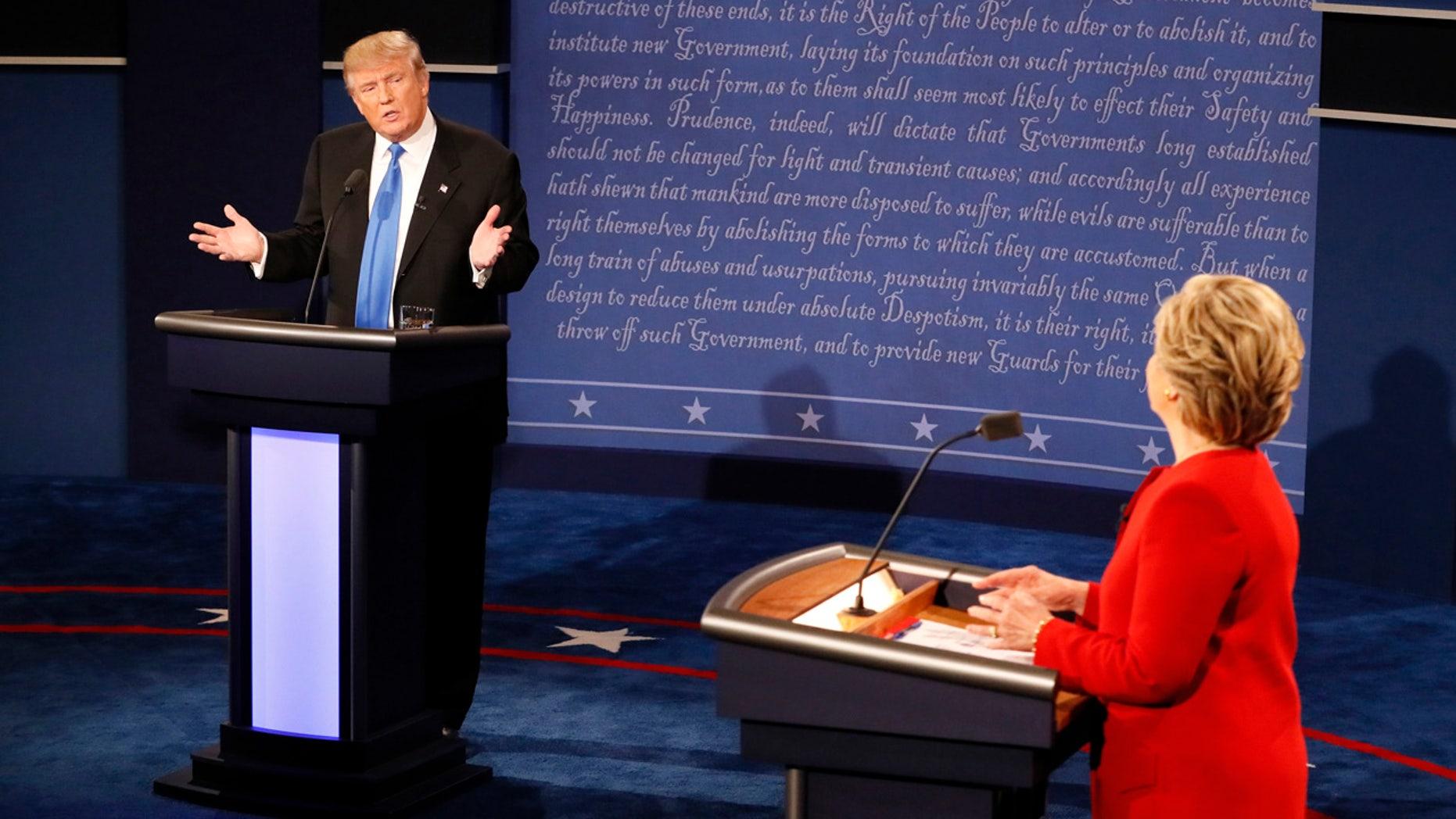 Republican presidential nominee Donald Trump gestures towards Democratic presidential nominee Hillary Clinton during the presidential debate at Hofstra University in Hempstead, N.Y., Monday, Sept. 26, 2016. (Rick T. Wilking/Pool via AP)