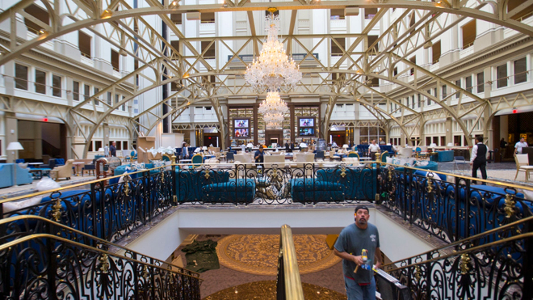 Workers move around inside the Trump International Hotel during it's 'soft-opening' in downtown Washington, Monday, Sept. 12, 2016 in Washington