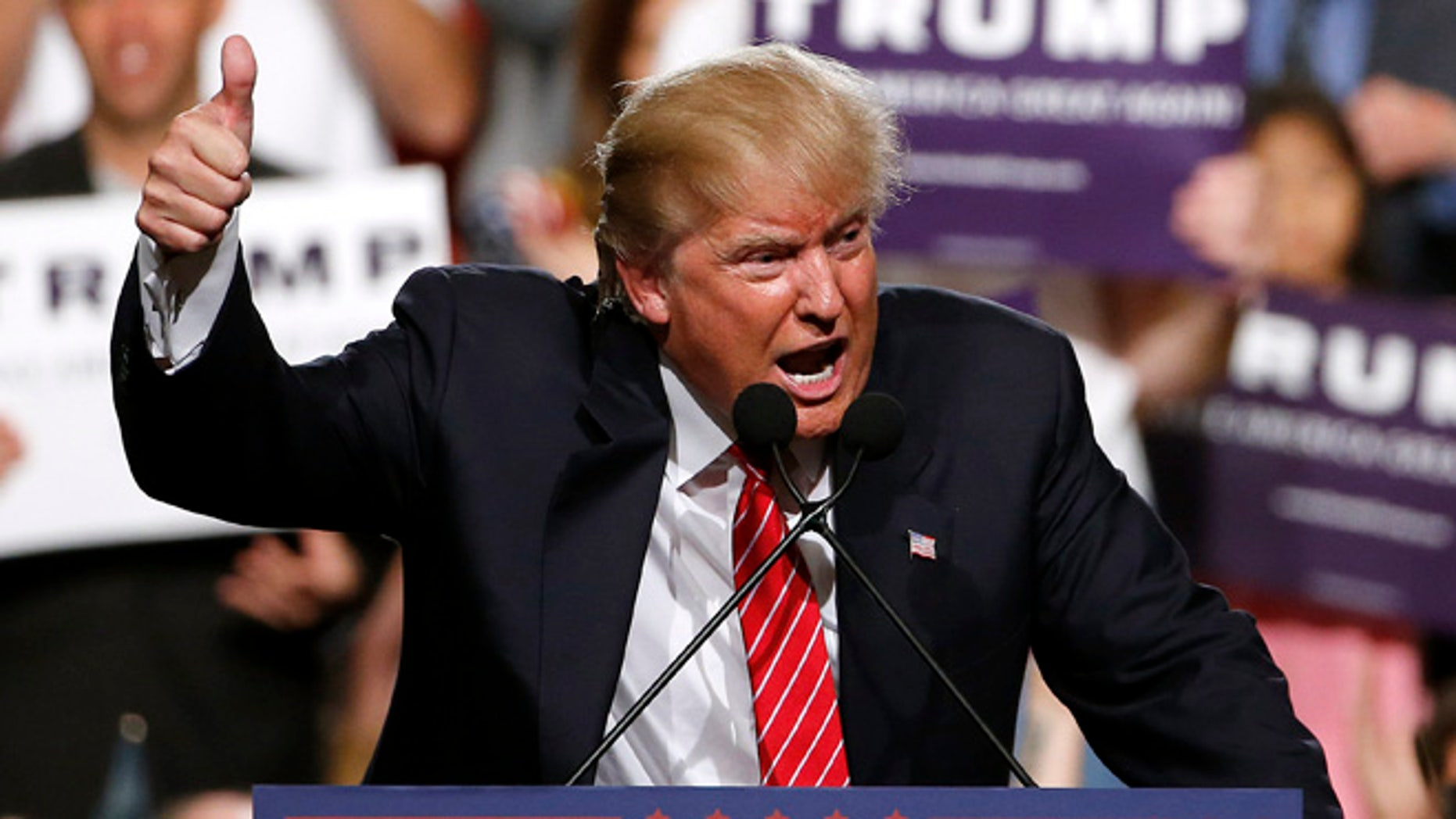 Republican presidential candidate Donald Trump finishes up speaking before a crowd of 3,500 Saturday, July 11, 2015, in Phoenix. (AP Photo/Ross D. Franklin)