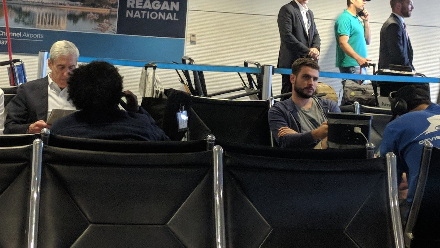 A photo obtained by POLITICO Playbook caught Special Counsel Robert Mueller (left) and Donald Trump Jr. (right) waiting in the same airport terminal leaving Reagan National Airport.