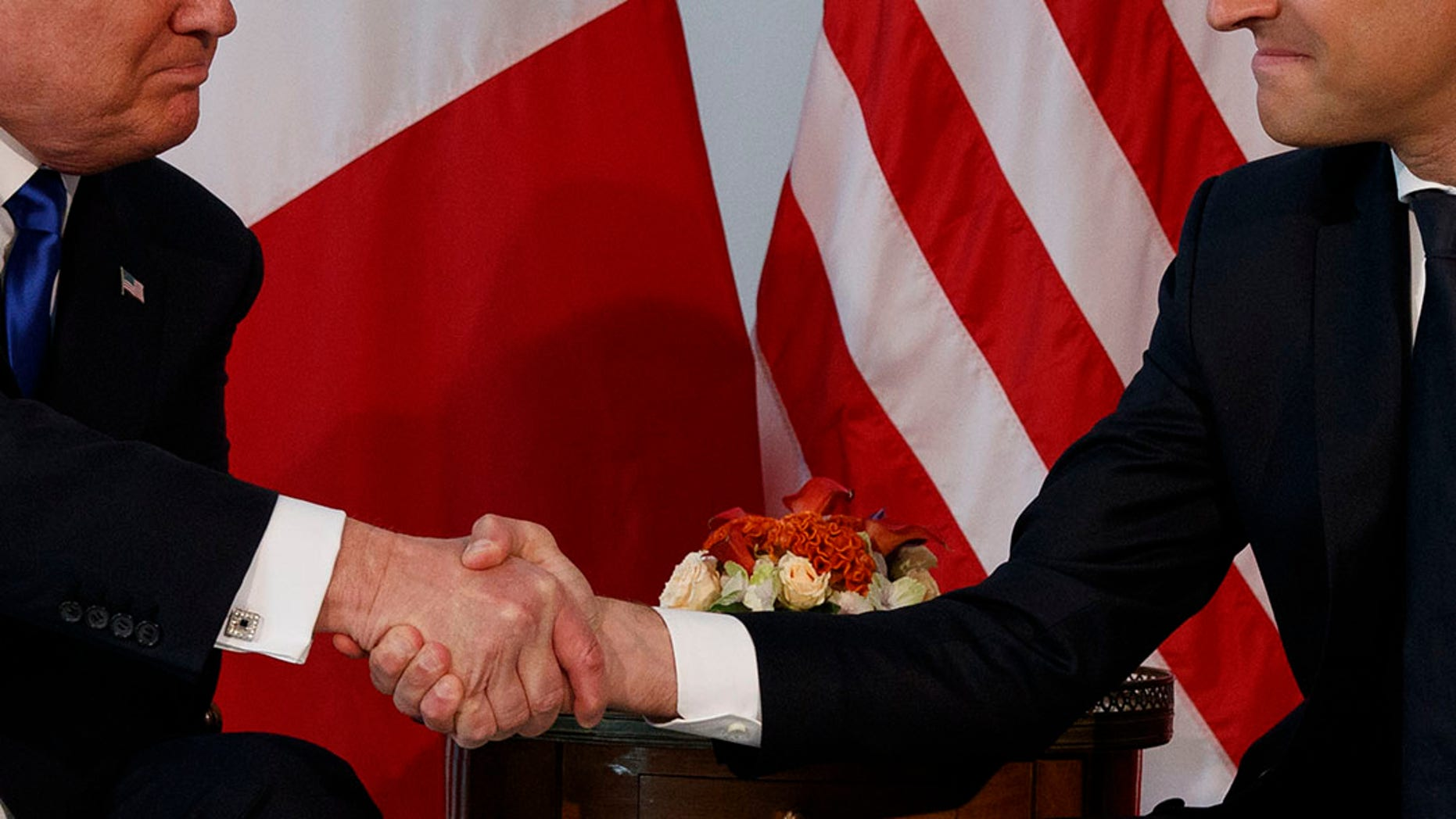 May 25, 2017: President Donald Trump shakes hands with French President Emmanuel Macron during a meeting at the U.S. Embassy in Brussels