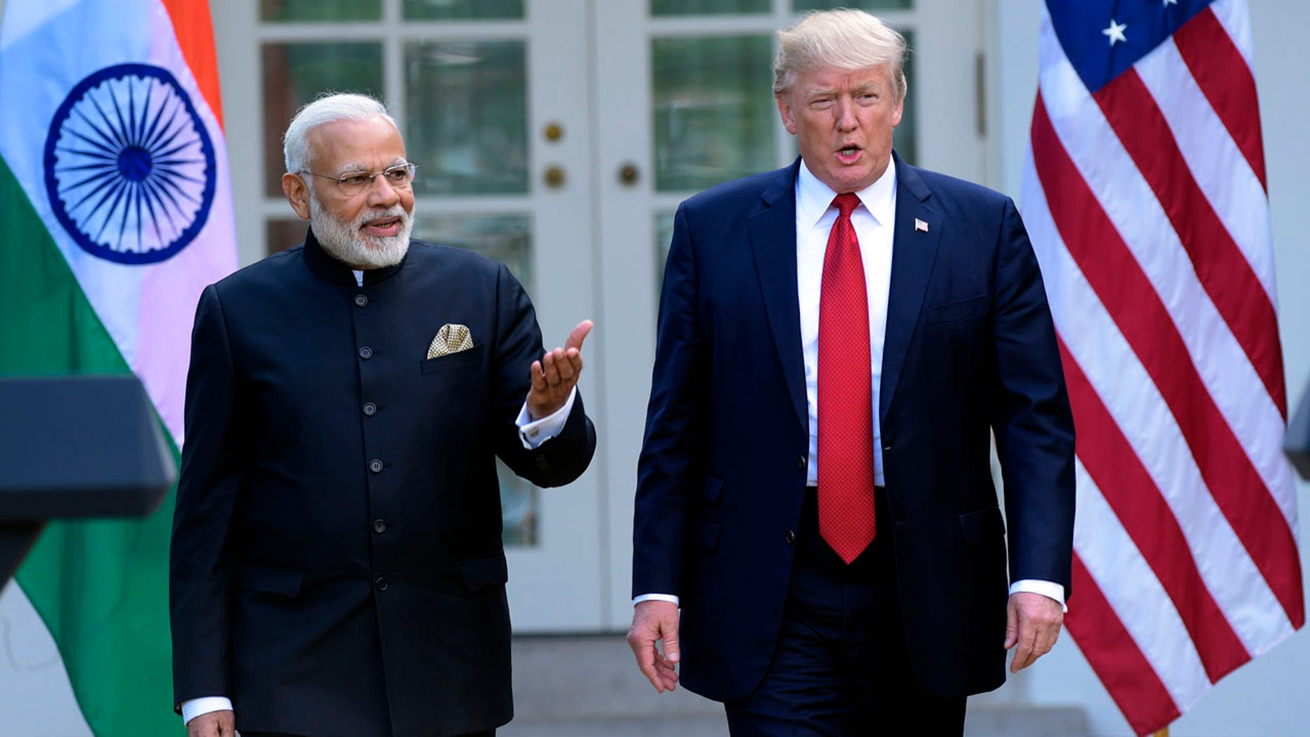 President Donald Trump and Indian Prime Minister Narendra Modi, step into the Rose Garden to make joint statements at the White House in Washington, Monday, June 26, 2017. (AP Photo/Susan Walsh)