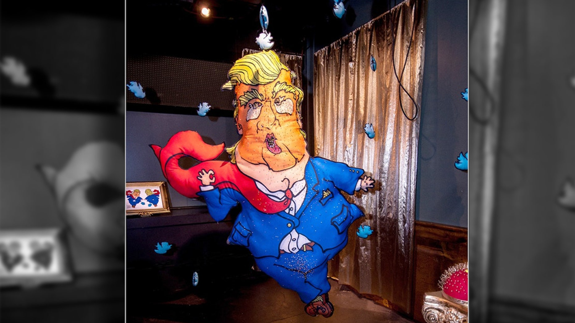 Art Prize, a national art contest held in Grand Rapid, Michigan, has allowed an artist to display a pin cushion in the image of President Donald Trump. The artist encouraged visitors to stick pins into the exaggerated likeness of the president. Over 10,000 pins have been stuck into the piece of art since it has been on display.