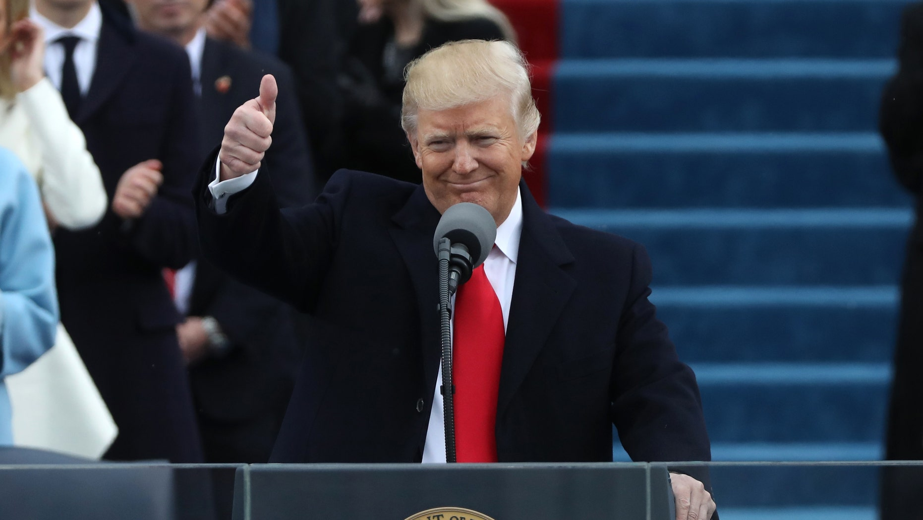 U.S. President Donald Trump gives a thumbs up after being sworn in as the 45th president of the United States on the West front of the U.S. Capitol in Washington, U.S., Jan. 20, 2017. (REUTERS/Carlos Barria)