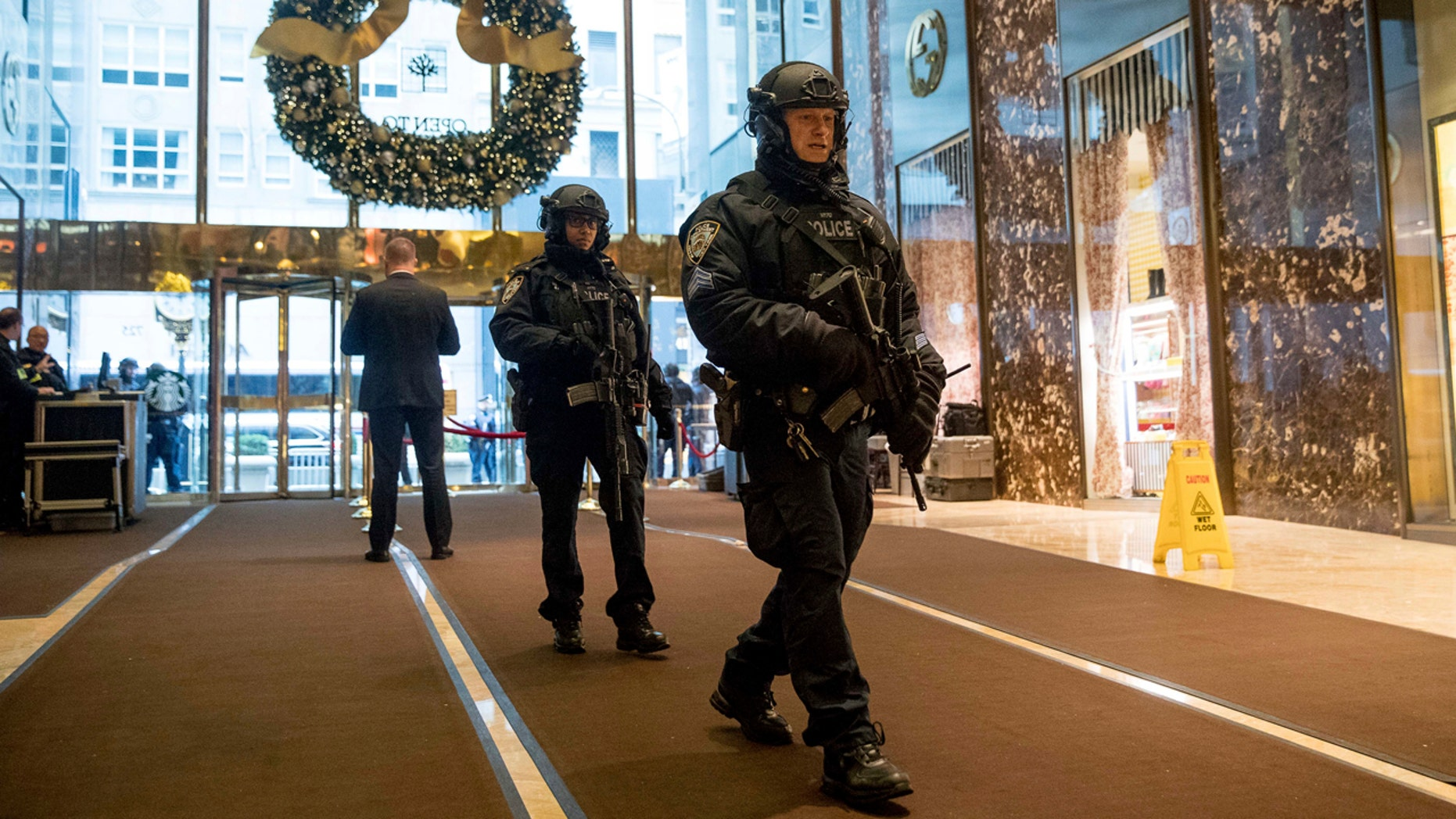 Dec. 5, 2016: Police officers walk through the lobby of Trump Tower in New York.