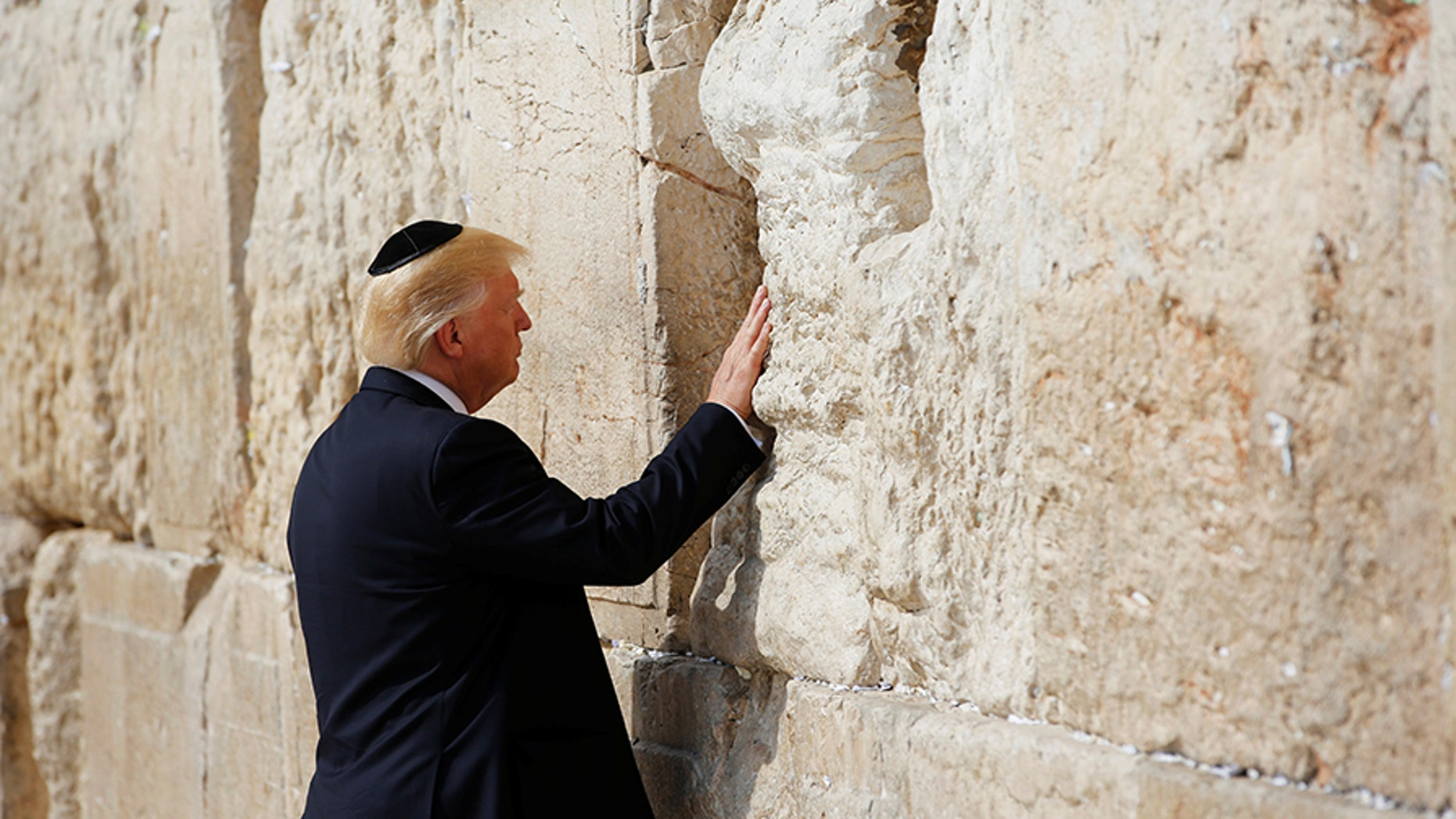 Israel's transportation minister is pushing ahead with a plan to extend Jerusalem's soon-to-open high speed rail line to the Western Wall, where he wants to name a future station after President Trump.