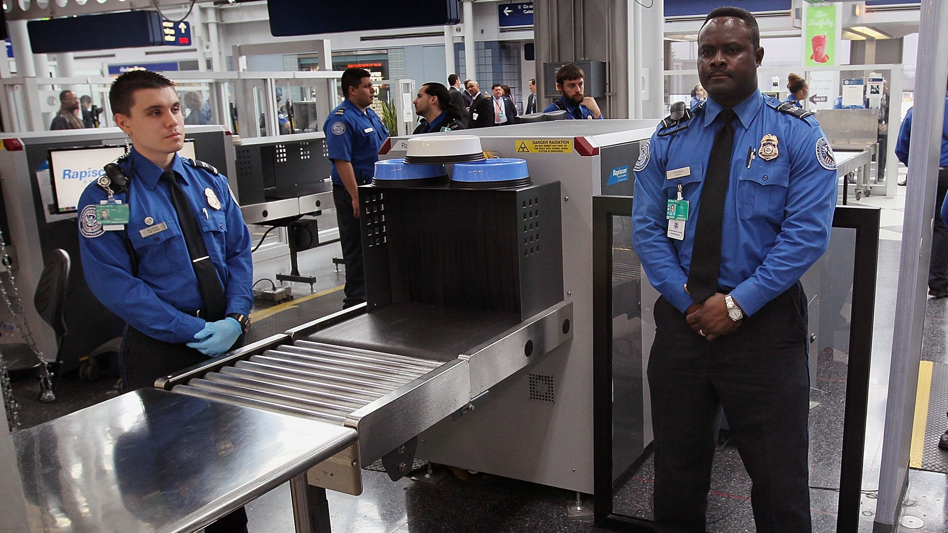 Transportation Security Administration (TSA) officers staff a checkpoint at O'Hare International Airport