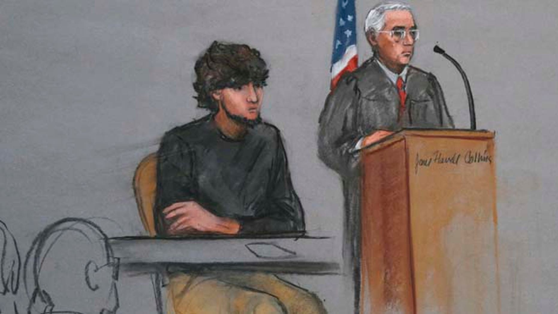 Jan. 5, 2015: Boston Marathon bombing suspect Dzhokhar Tsarnaev, left, is depicted beside U.S. District Judge George O'Toole Jr., right, as O'Toole addresses a pool of potential jurors in a jury assembly room at the federal courthouse, in Boston.