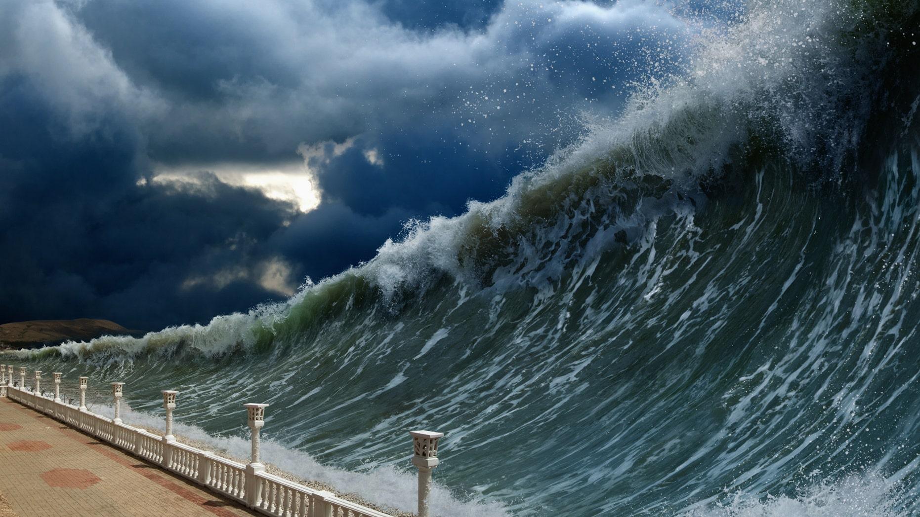 Apocalyptic dramatic background - giant tsunami waves, dark stormy sky (Ig0rZh) (Credit: iStock)