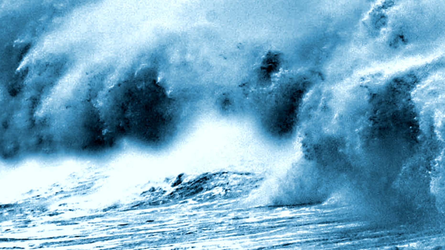 May 25, 2001: A giant wave lashes a popular promenade in Bombay, India.