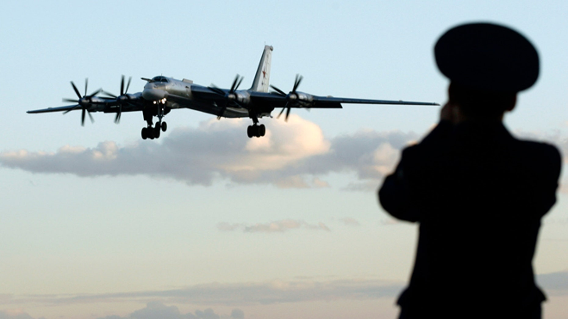 FILE: August 7, 2008: A Russian officer takes a picture of a Tu-95 bomber at a military airbase in Engels, roughly 559 miles south of Moscow.