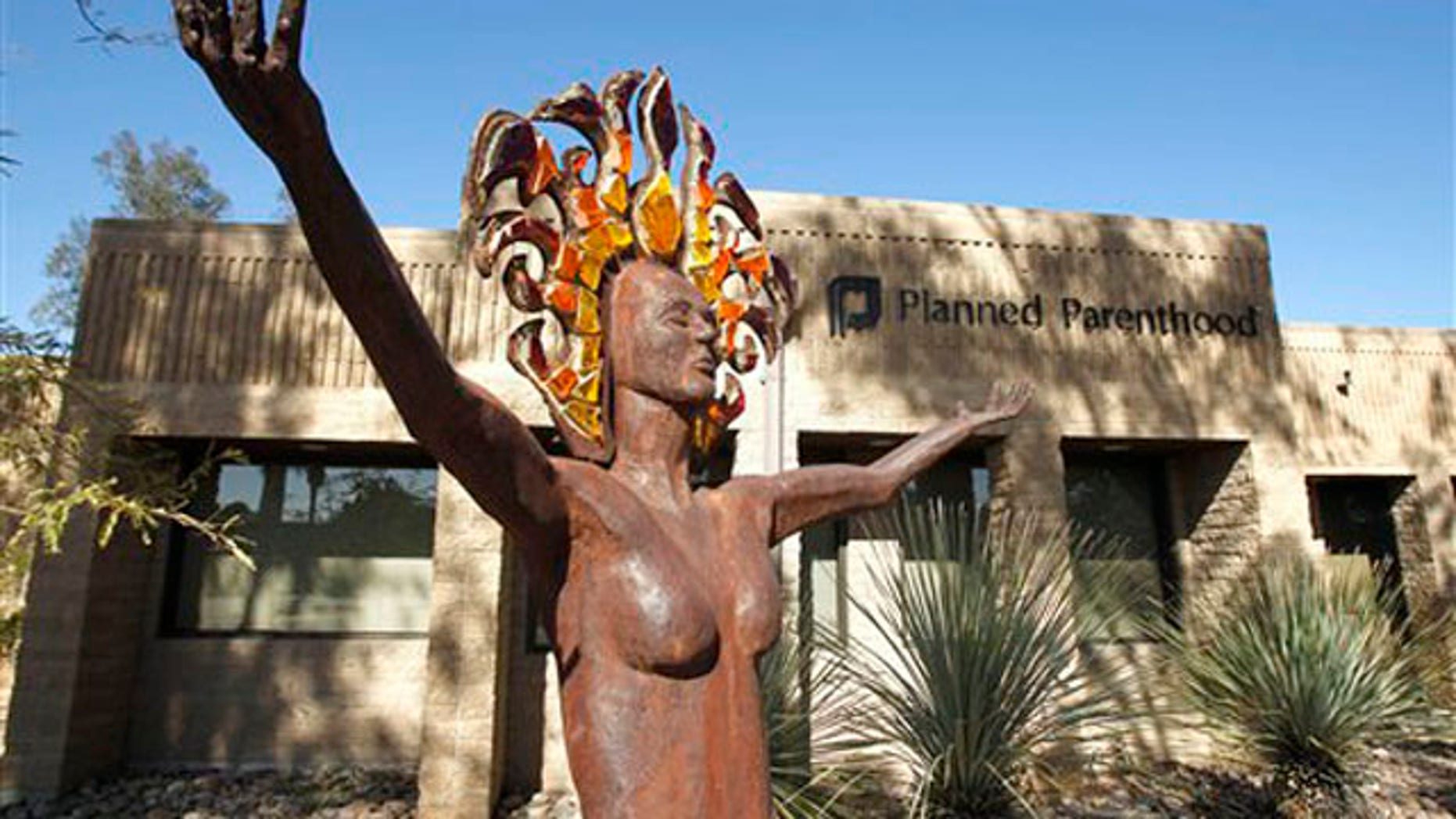 In this Jan. 23 2011 photo, a statue representing women's empowerment stands in front of a Planned Parenthood facility in Tucson, Ariz.