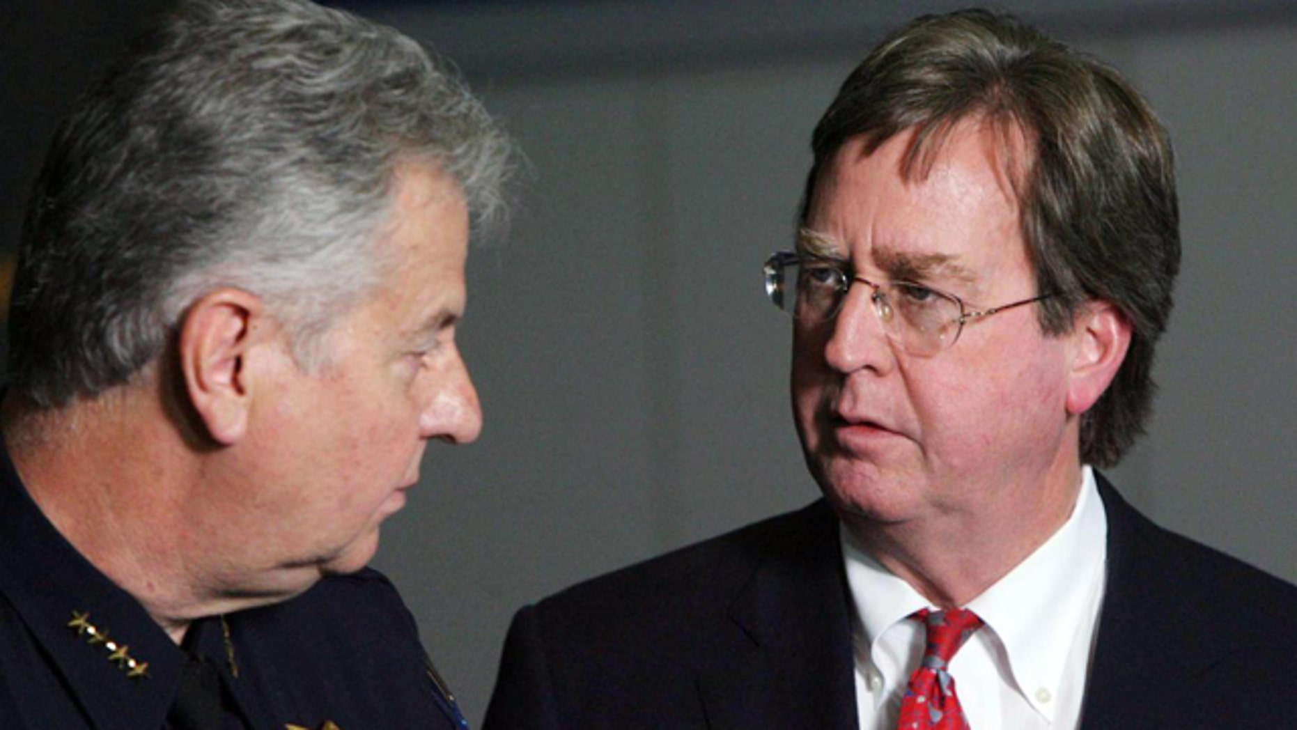 April 7, 2012: Tulsa Mayor Dewey Bartlett, right, chats with Tulsa Chief of Police Chuck Jordan during a news conference at the Tulsa Police Department in downtown Tulsa, Okla.