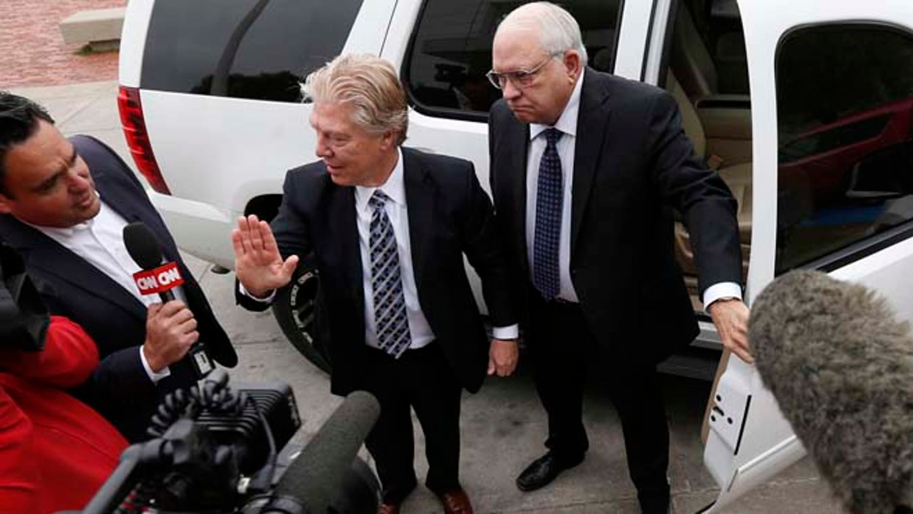 April 14, 2015: Robert Bates, right, arrives at the Tulsa County Jail with his attorney, Clark Brewster in Tulsa, Okla.