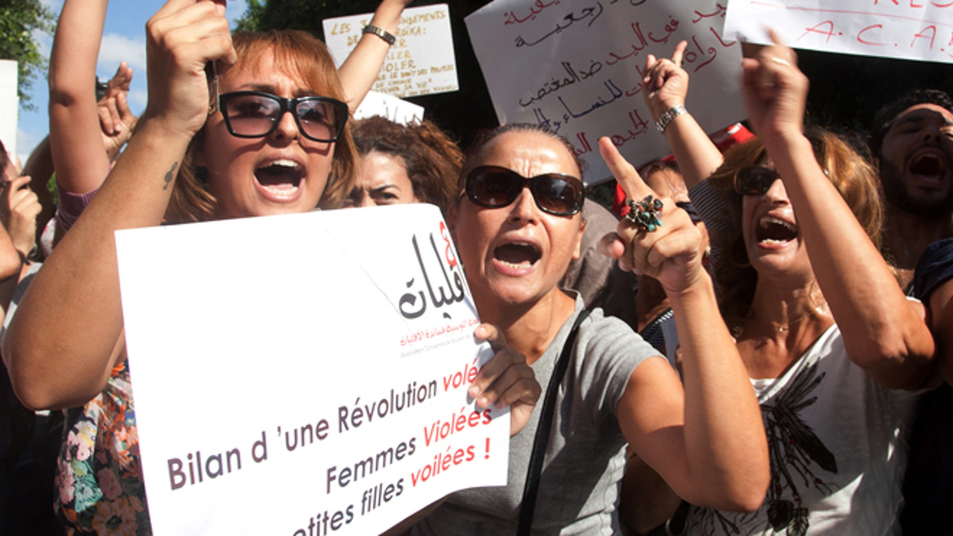 Oct. 2, 2012: Hundreds of Tunisian women protest  in support of a woman who says she was raped by police and is facing accusations of violating modesty laws in Tunis.