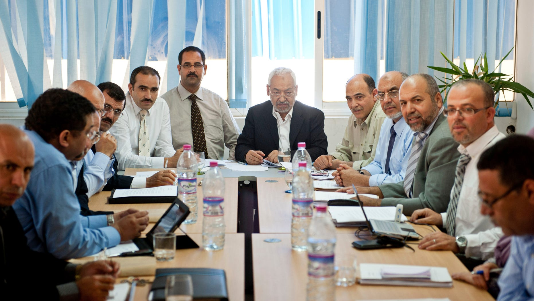 Oct. 27, 2011: Tunisian leader and founder of the moderate islamist party Ennahda, Rached Ghannouchi, center right, chairs an executive board at the party's headquarters in Tunis.