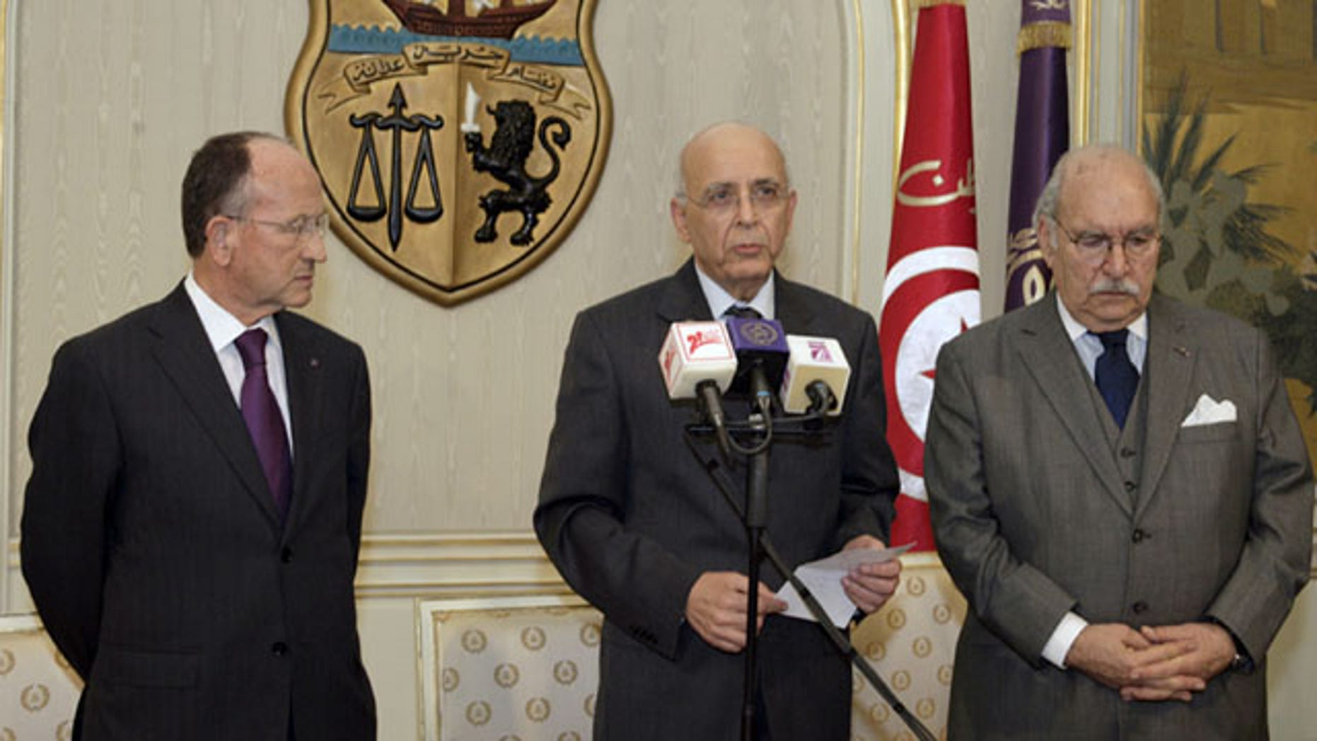Jan. 14: Prime Minister of Tunisia, Mohammed Ghannouchi, center,  before he addressed the nation to announce that he is assuming power in Tunisia.